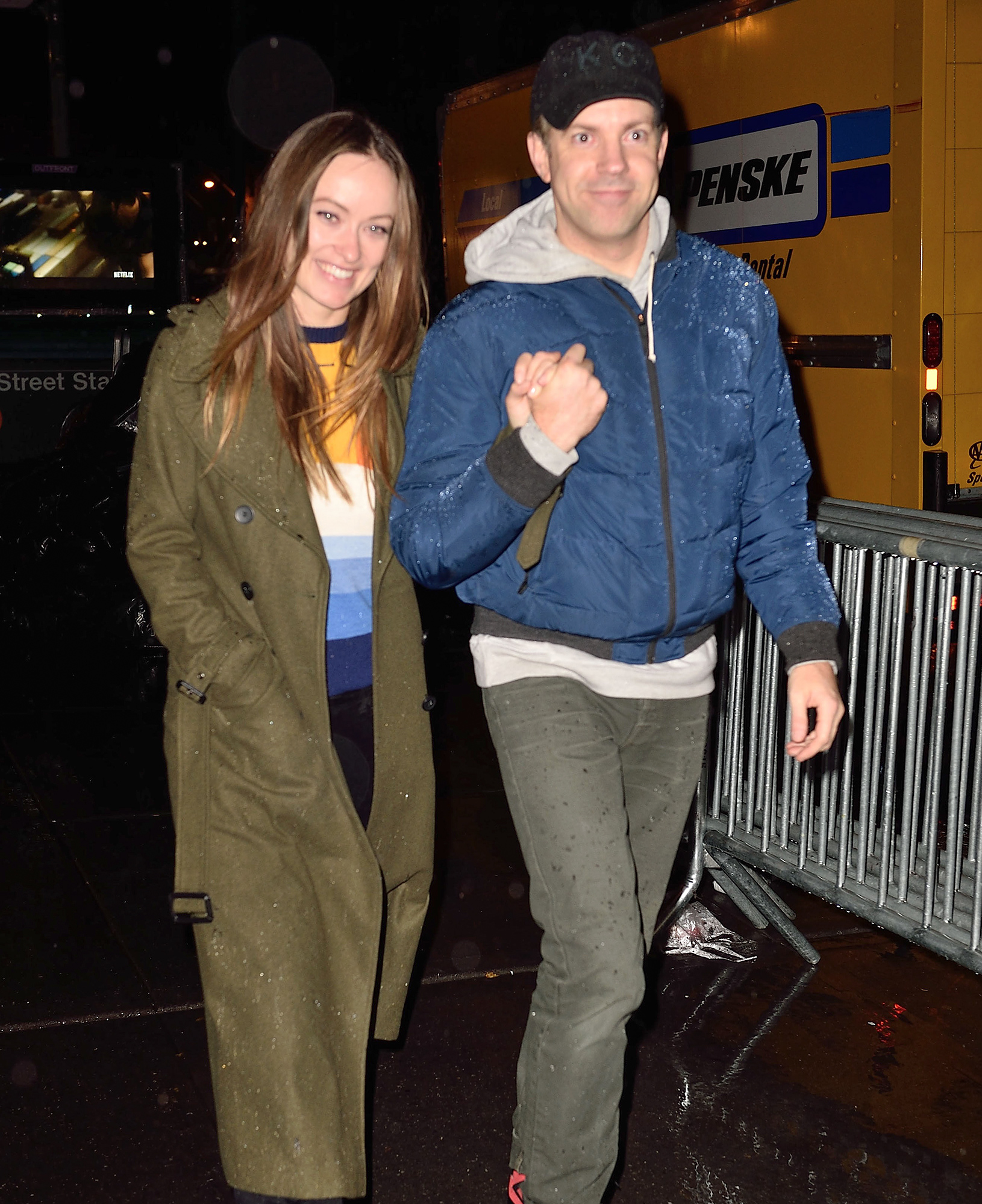 EXCLUSIVE: Olivia Wilde and Jason Sudeikis arrive hand in hand in the rain at the Saturday Night Live party in NYC.