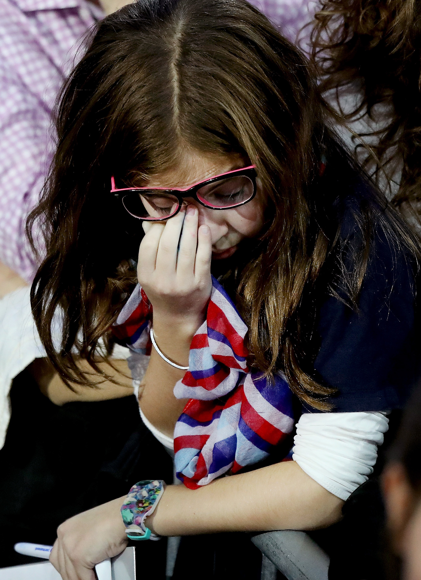 NEW YORK, NY - NOVEMBER 08: A young girl rubs her eyes as she watches voting results come in at Democratic presidential nominee former Secretary of State Hillary Clinton's election night event at the Jacob K. Javits Convention Center November 8, 2016 in New York City. Clinton is running against Republican nominee, Donald J. Trump to be the 45th President of the United States. (Photo by Drew Angerer/Getty Images) Getty Images North America 681261599 621810522