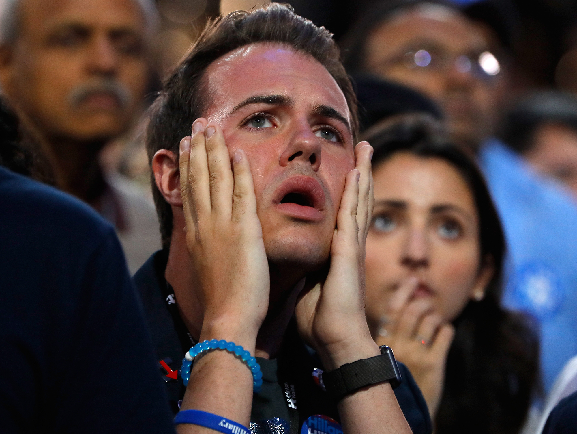 NEW YORK, NY - NOVEMBER 08: A man reacts as he watches voting results at Democratic presidential nominee former Secretary of State Hillary Clinton's election night event at the Jacob K. Javits Convention Center November 8, 2016 in New York City. Clinton is running against Republican nominee, Donald J. Trump to be the 45th President of the United States. (Photo by Aaron P. Bernstein/Getty Images) Getty Images North America 681261599 621802304