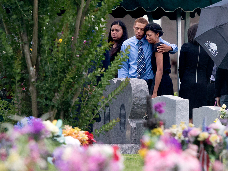 Mourners embrace during a graveside burial for Kimberly Morris, one of the victims of the Pulse nightclub mass shooting, Thursday, June 16, 2016, in Kissimmee, Fla. (AP Photo/David Goldman)