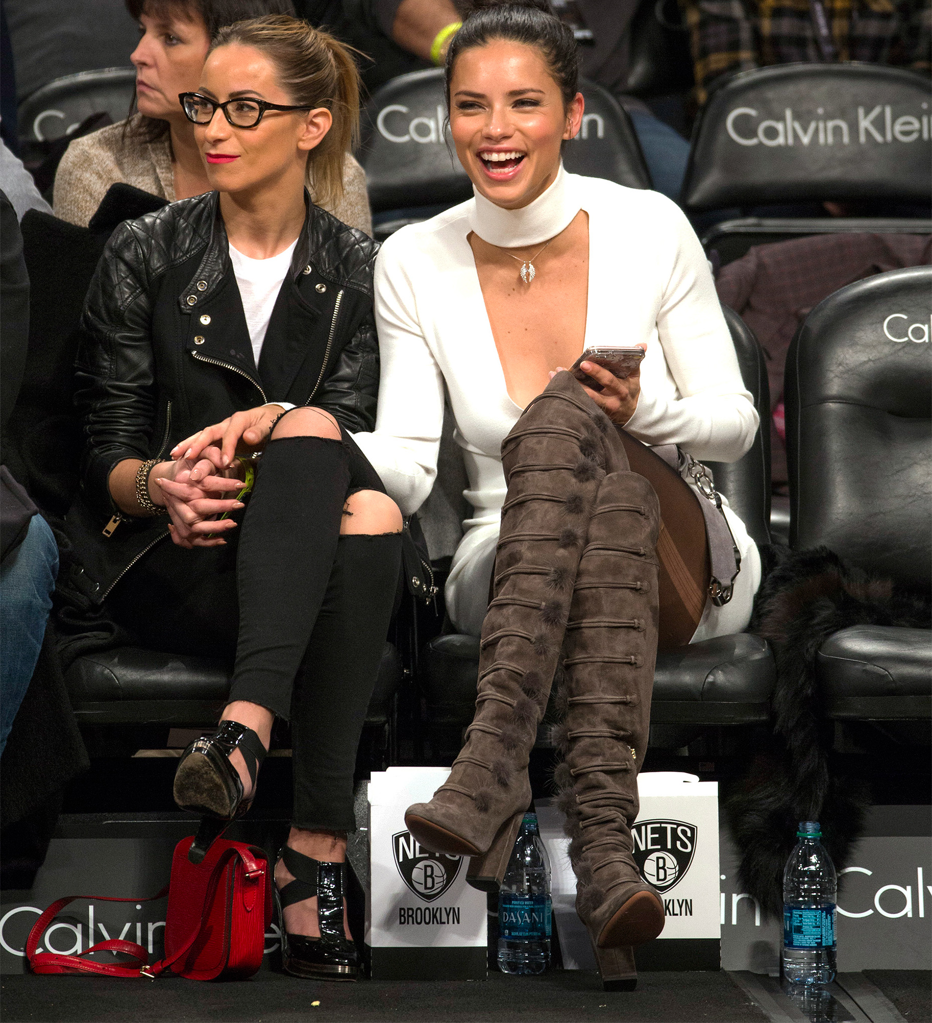 Victoria's Secret model Adriana Lima sits court side as the Brooklyn Nets play the Los Angeles Lakers at Barclays Center in New York