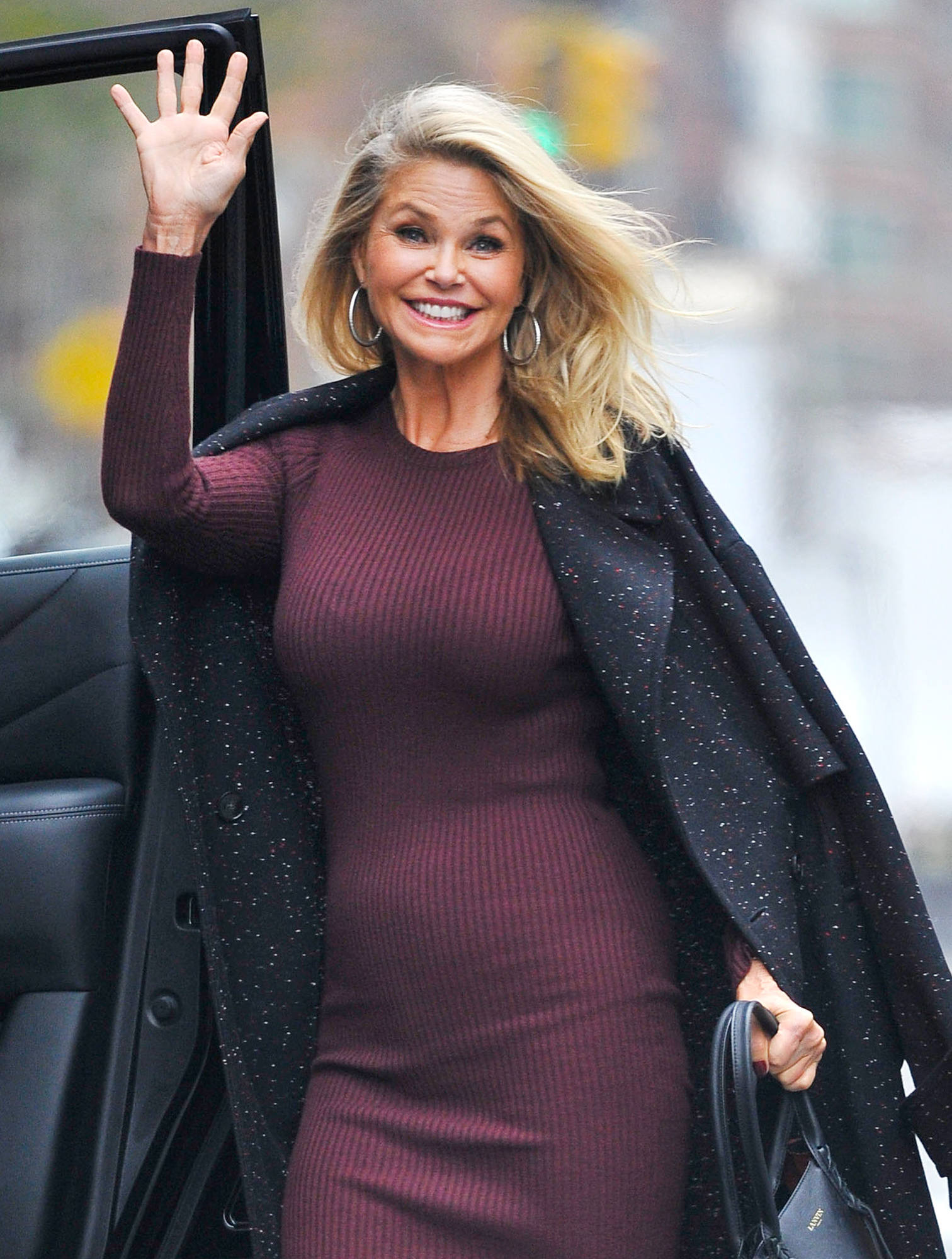 EXCLUSIVE: Christie Brinkley wears a form-fitting burgundy dress in New York City