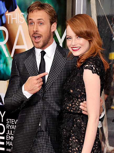 """NEW YORK, NY - JULY 19: Actors Ryan Gosling (L) and Emma Stone pose on the red carpet at the """"Crazy, Stupid, Love."""" World Premiere at the Ziegfeld Theater on July 19, 2011 in New York City. (Photo by D Dipasupil/FilmMagic) 119389694"""