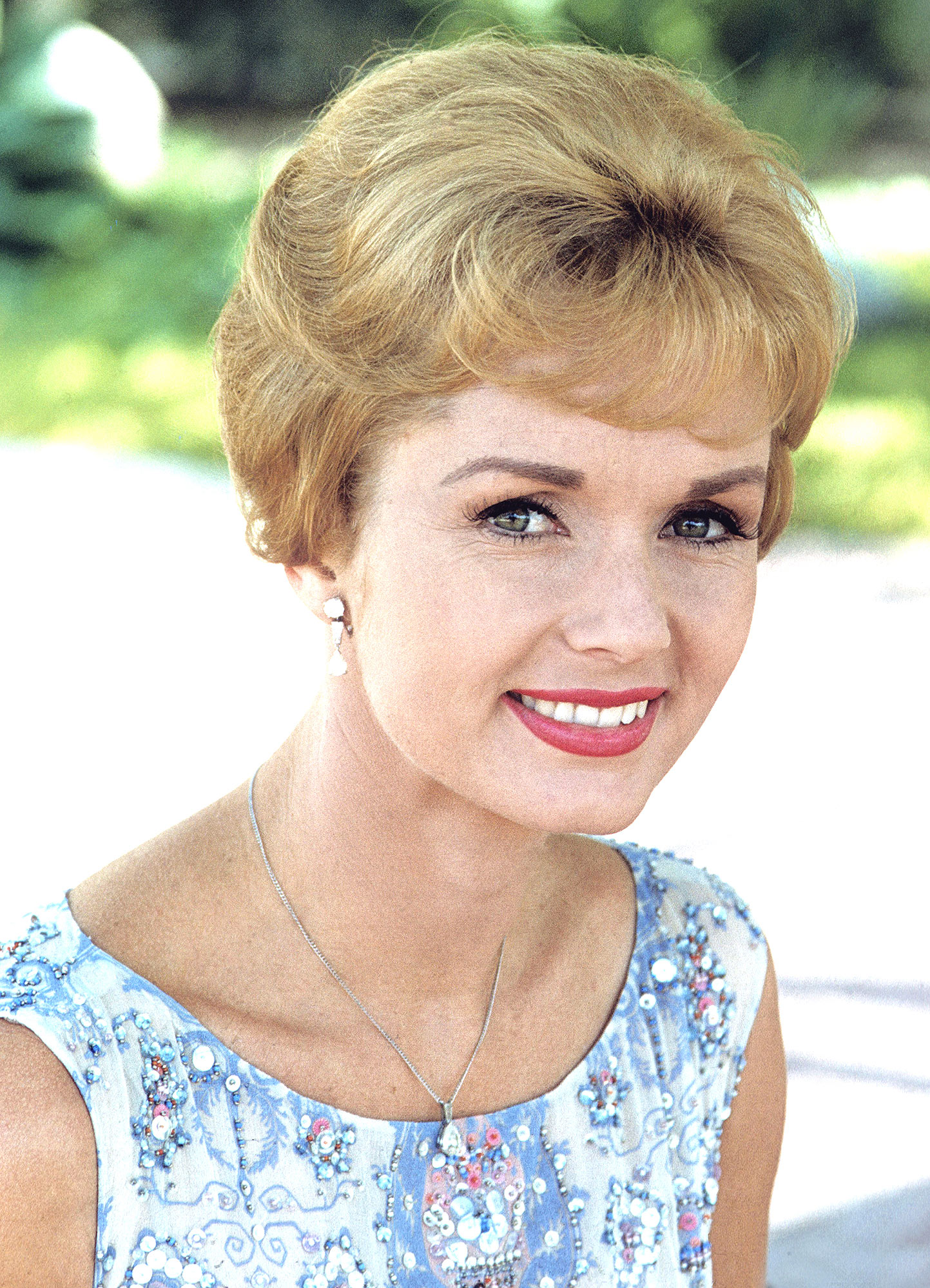 Headshot of Debbie Reynolds, US actress, singer and dancer, wearing a blue and white print pattern sleeveless top, circa 1970. (Photo by Silver Screen Collection/Getty Images)
