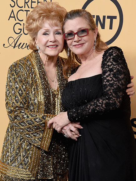 Debbie Reynolds (L) and actress Carrie Fisher pose in the press room at the 21st Annual Screen Actors Guild Awards at The Shrine Auditorium on January 25, 2015 in Los Angeles, California.