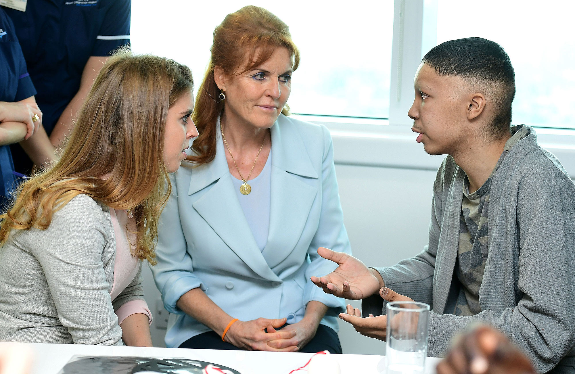Princess Beatrice (left) and the Duchess of York meet Harry Sadler,17 from Colchester, during a visit to the Teenage Cancer Trust's young persons unit at University College Hospital, London. (Photo by Ian West/PA Images via Getty Images)