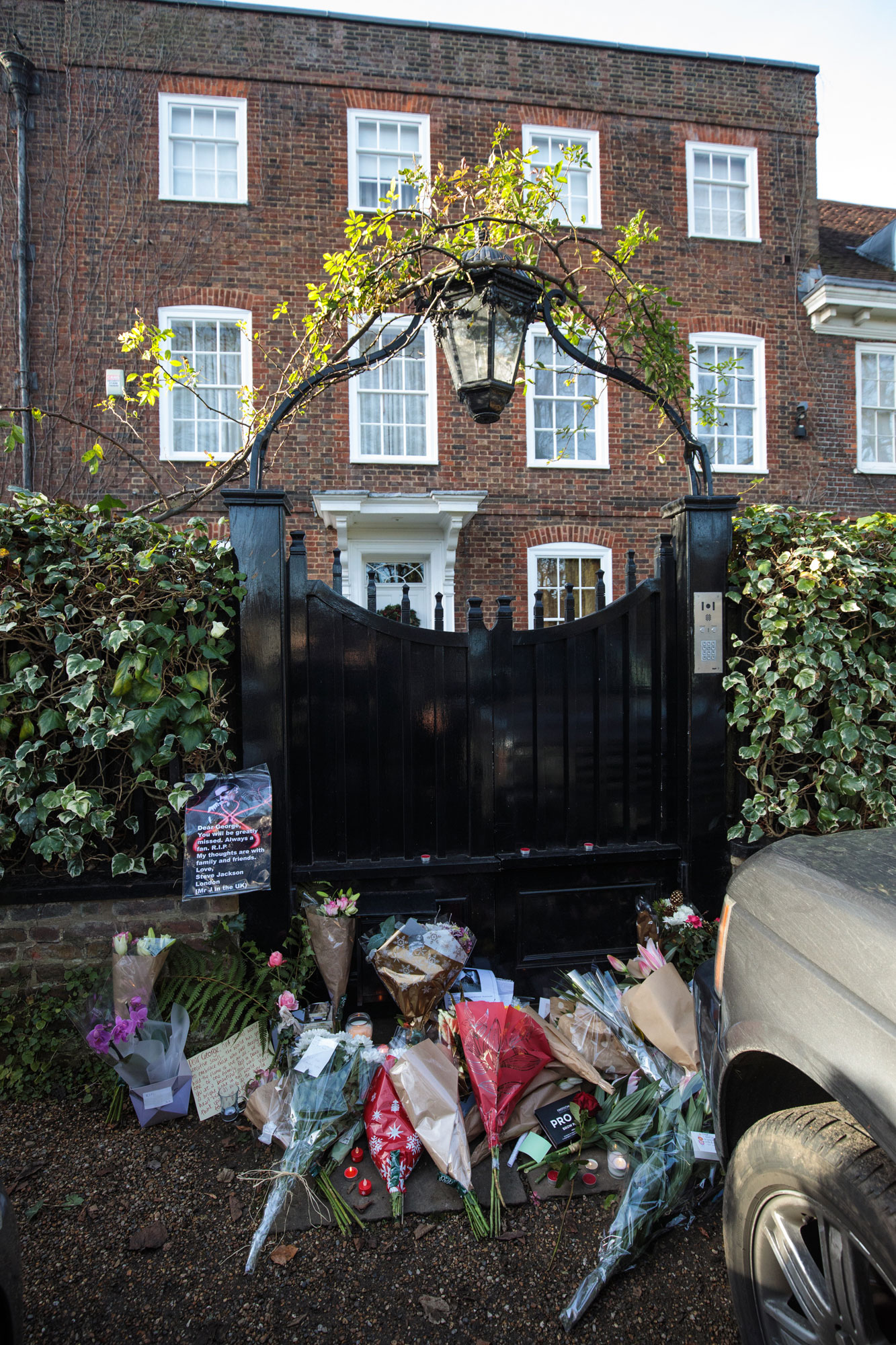 The gate is closed behind tributes of flowers left at the home of pop music icon George Michael in The Grove, Highgate on December 26, 2016 in London, England. Singer George Michael died on Christmas day in his country home in Oxfordshire at the age of 53 on December 25.