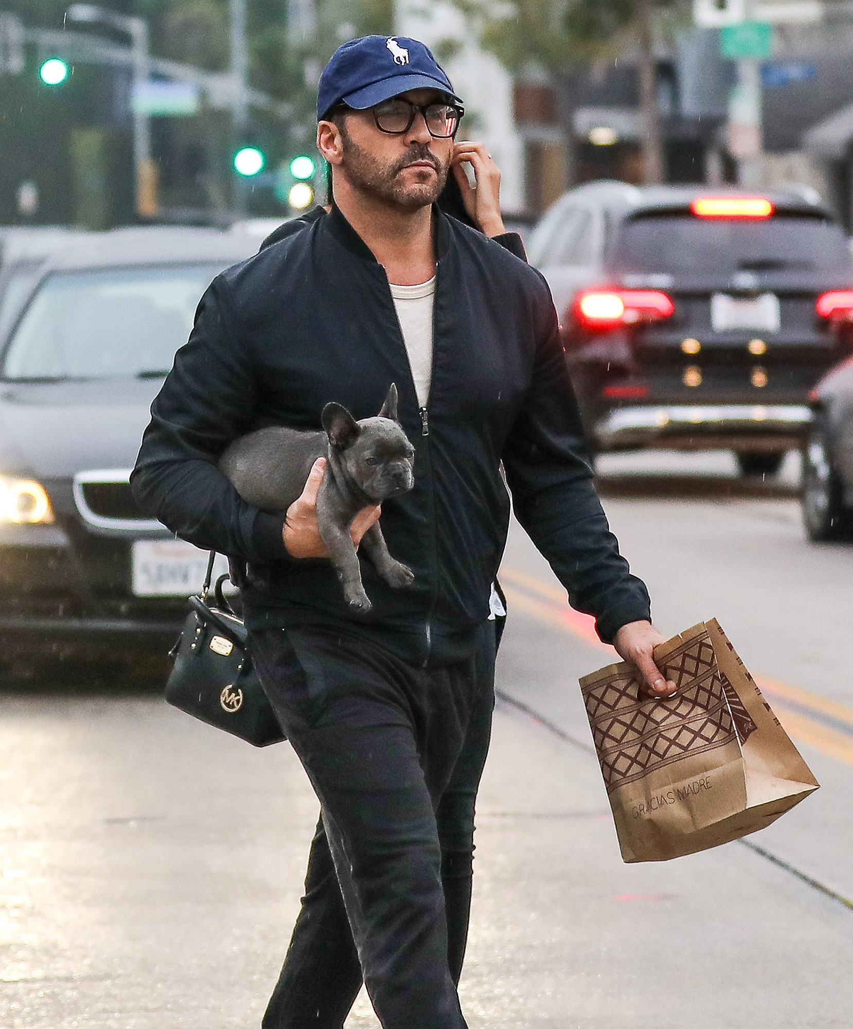*EXCLUSIVE* Jeremy Piven brings his pup and a mystery woman along to Gracias Madre