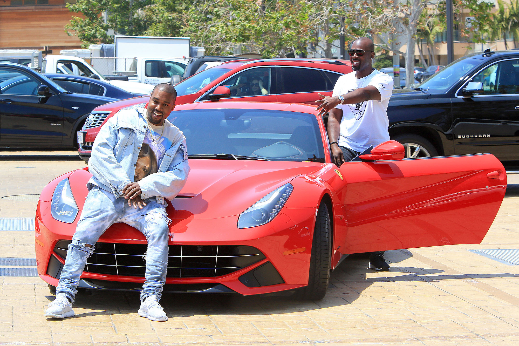 Kanye Poses On Corey Gamble's New Red Ferrari Leaving Lunch