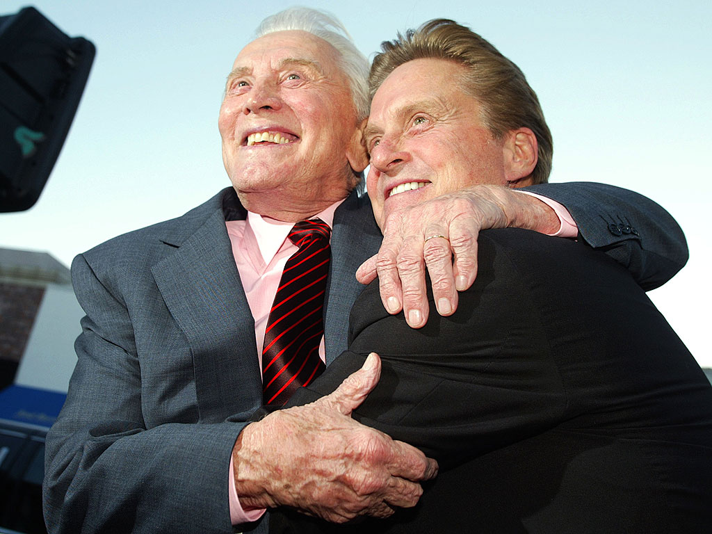 """Actor Kirk Douglas (L) and son producer/actor Michael Douglas arrive at the premiere of """"It Runs In The Family"""" at the Bruin Theater April 7, 2003 in Los Angeles."""