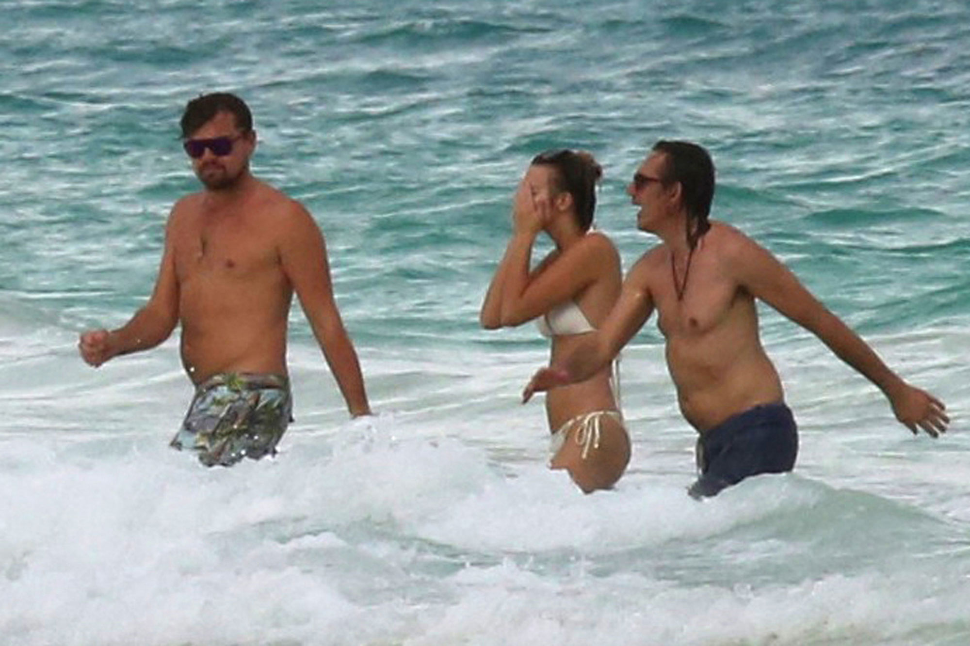Leonardo DiCaprio and his buddy Lukas Haas swim in Cancun