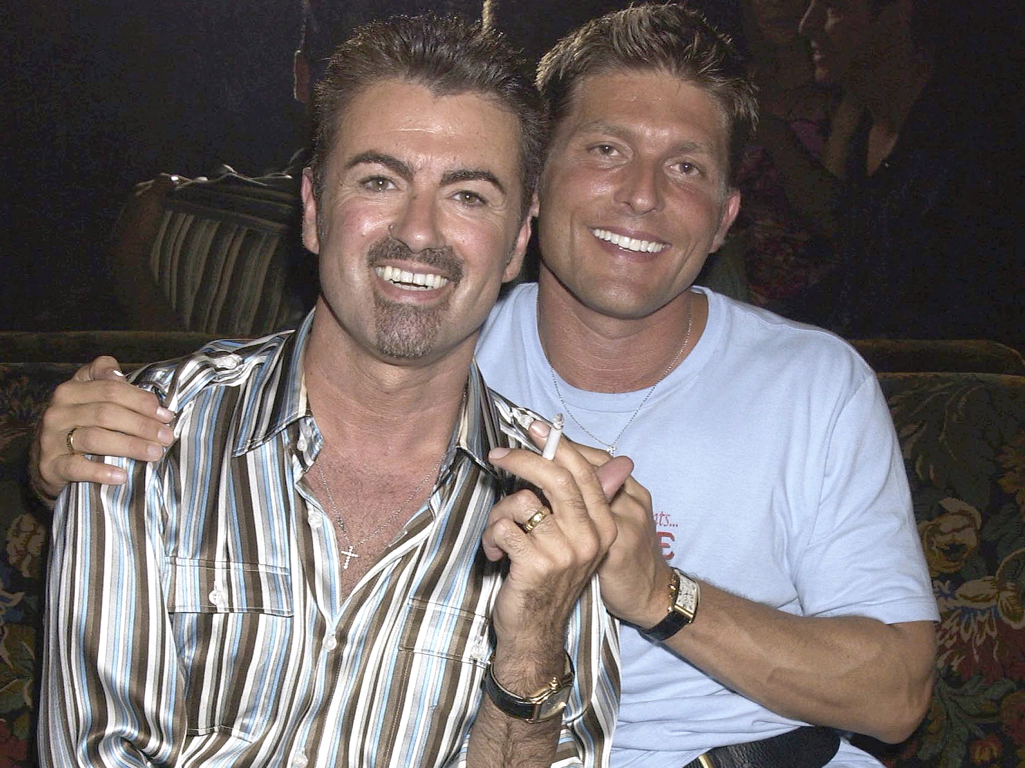 PARIS - JULY 09: Singer, George Michael and partner Kenny Goss attend the Versace Couture Launch Party, thrown by Donatella Versace at The Ritz Hotel on 9th July 2002, in Paris. (Photo by Dave Benett/Getty Images).