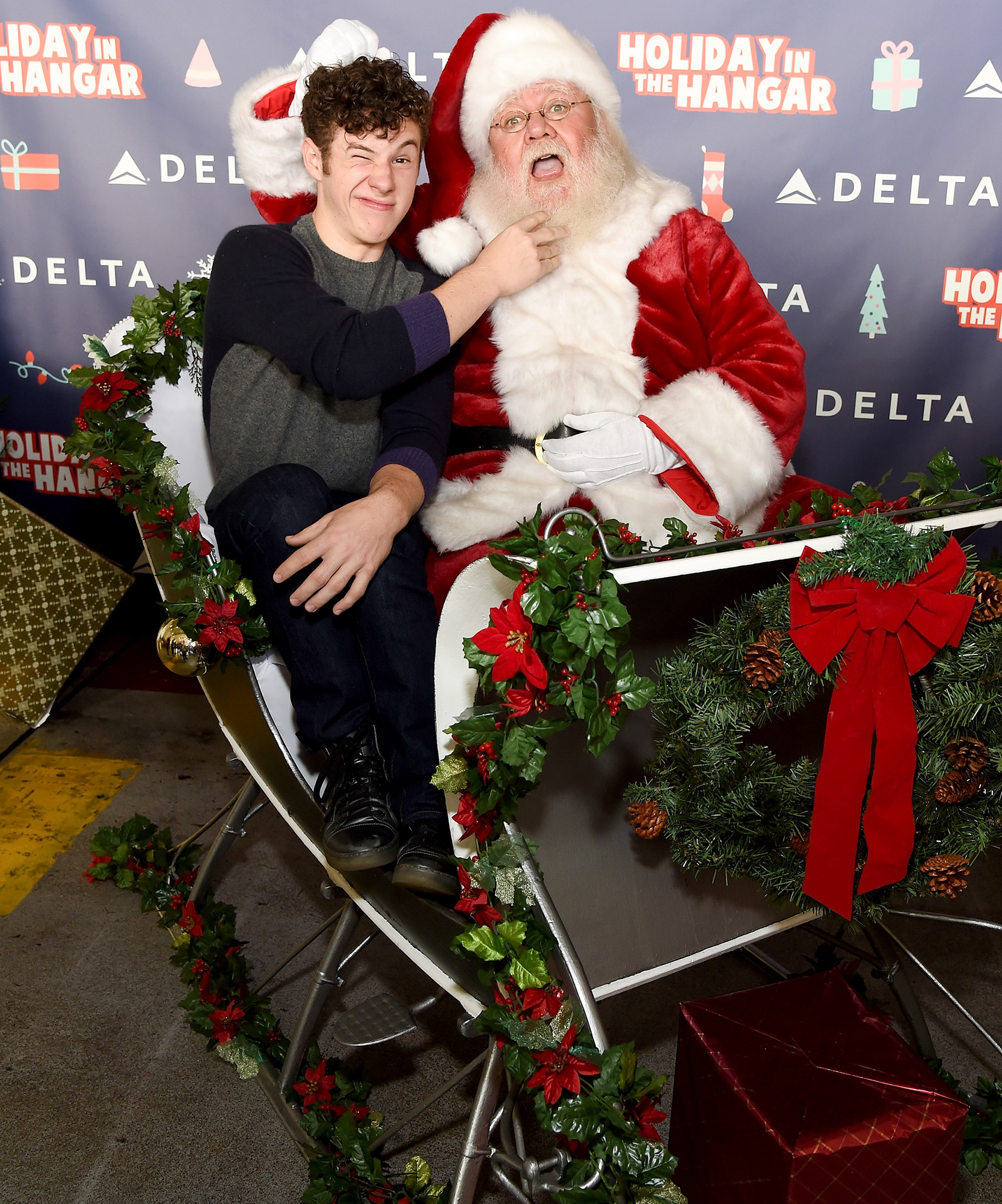 """Delta Air Lines Hosts Sixth Annual Holiday """"Flight"""" To The North Pole For 150 Kids From Children's Hospital Los Angeles And P.S. ARTS At LAX"""