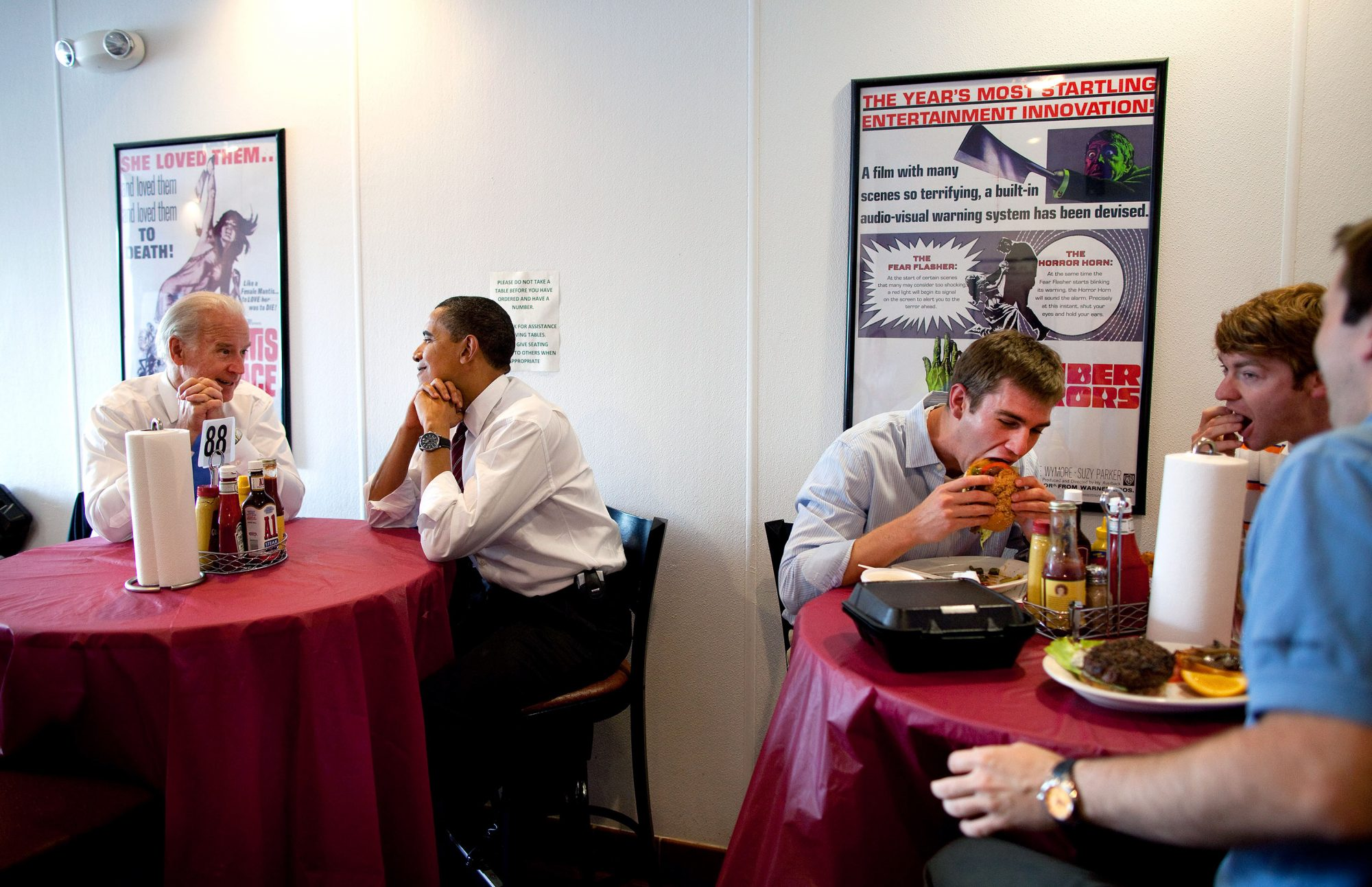 President Barack Obama and Vice President Joe Biden wait for their lunch during an unannounced visit to Rays' Hell Burger in Arlington, Va., May 5, 2009. Official White House Photo by Pete Souza. This official White House photograph is being made available for publication by news organizations and/or for personal use printing by the subject(s) of the photograph. The photograph may not be manipulated in any way or used in materials, advertisements, products, or promotions that in any way suggest approval or endorsement of the President, the First Family, or the White House. This official White House photograph is being made available for publication by news organizations and/or for personal use print The White House Official Photographer