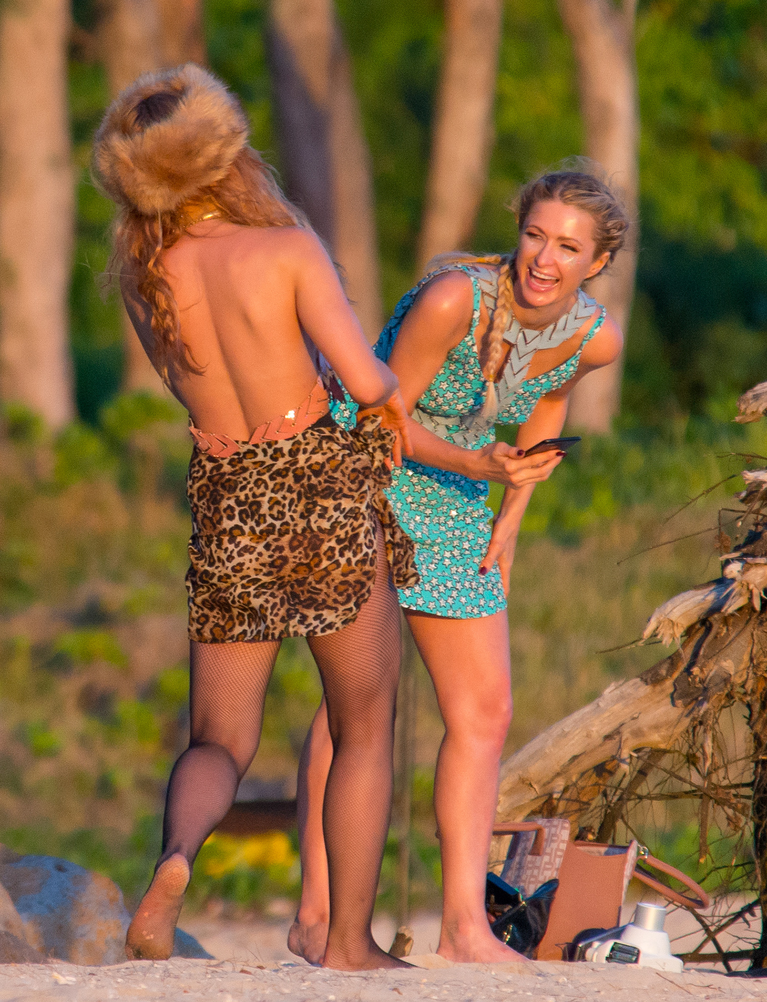 EXCLUSIVE: Paris Hilton and friend have photoshoot at sunset