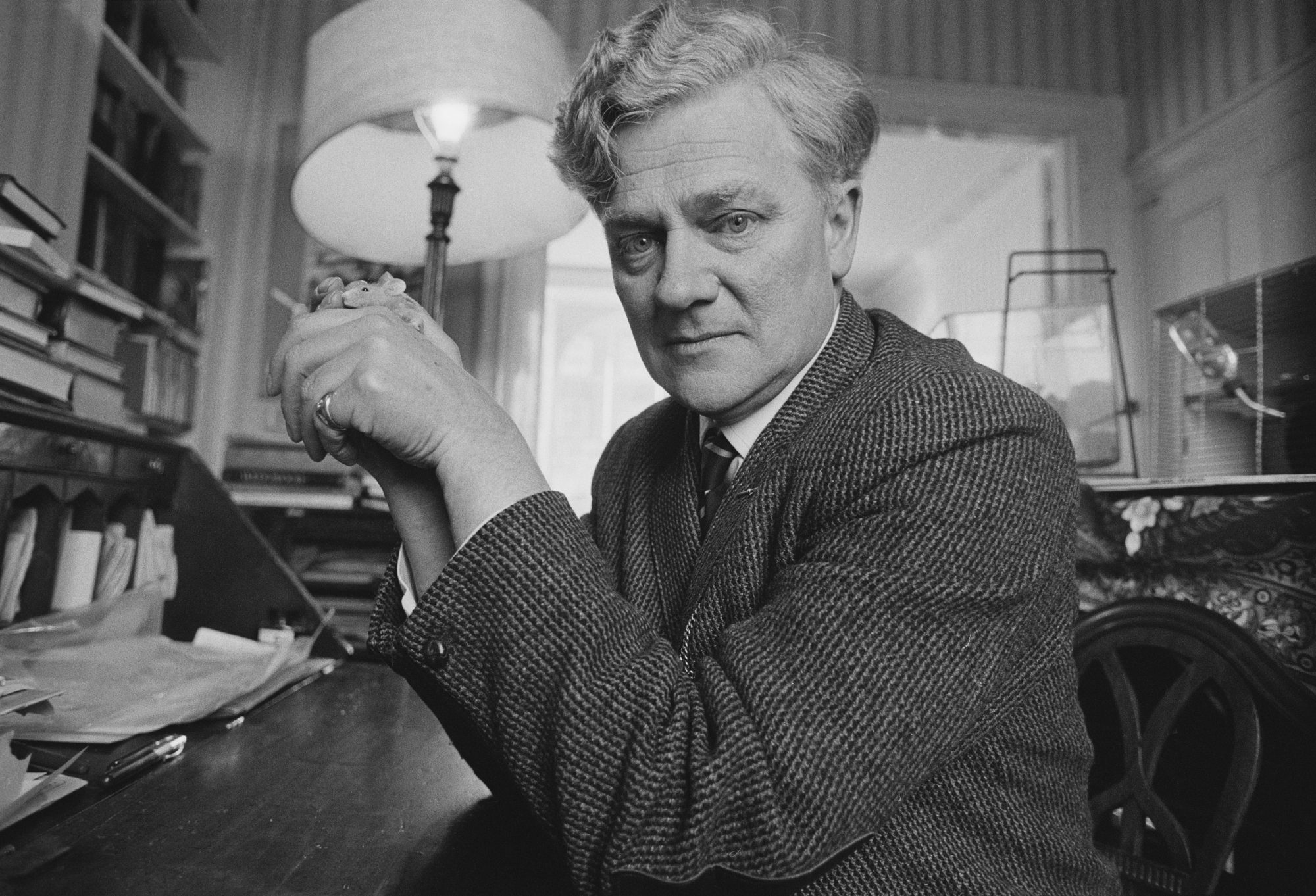 English novelist Richard Adams holding a pet mouse, 3rd March 1974. (Photo by Tom Smith/Daily Express/Hulton Archive/Getty Images)