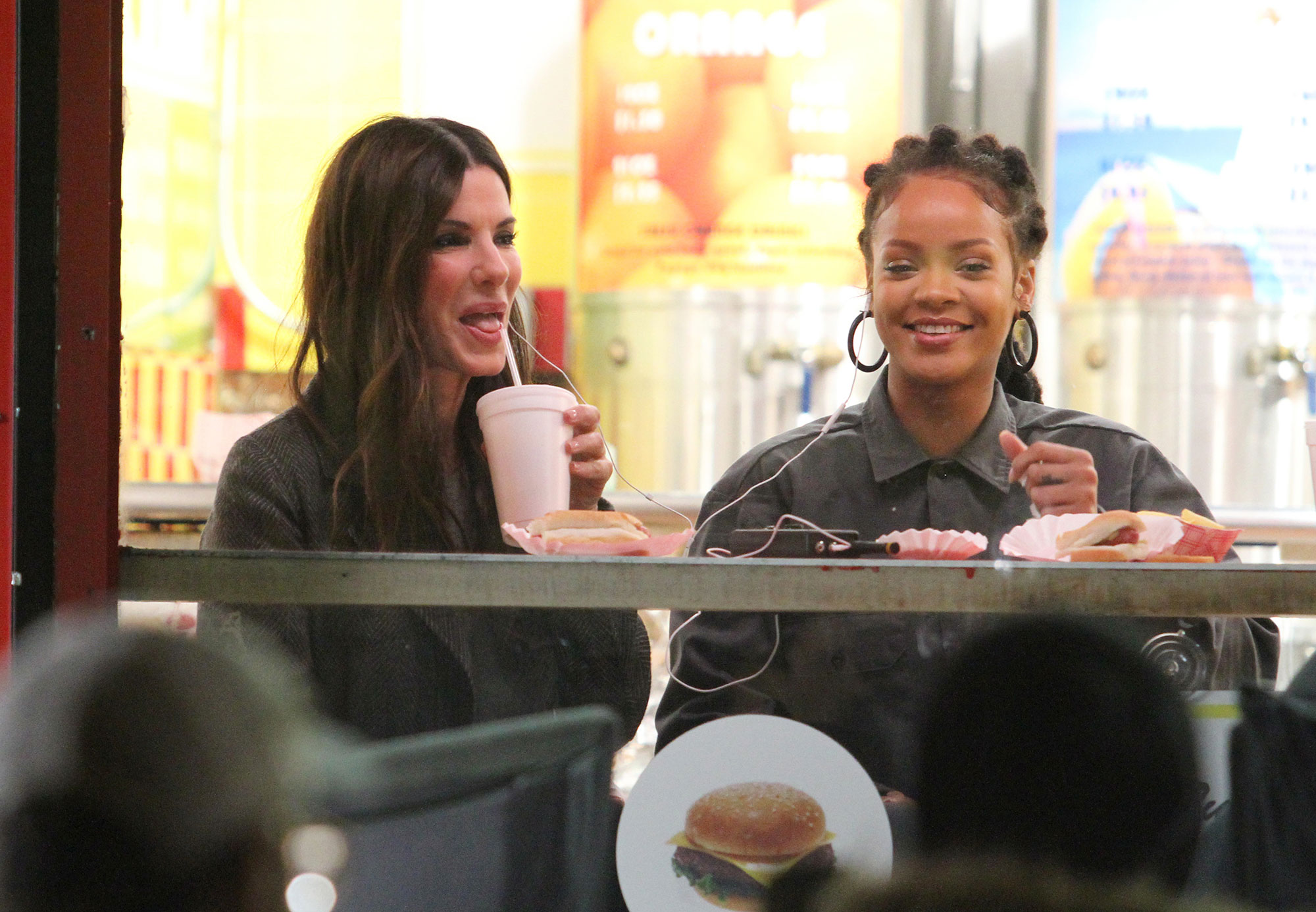 """Sandra Bullock and Rihanna spotted eating hot dogs and french fries on the set of """"OCEANS 8"""" while filming in Manhattan's PAPAYA DOG fast food restaurant located in the Wall Street area in NYC, New York. 07 Dec 2016 Pictured: Sandra Bullock, Rihanna. Photo credit: LRNYC / MEGA TheMegaAgency.com +1 888 505 6342"""