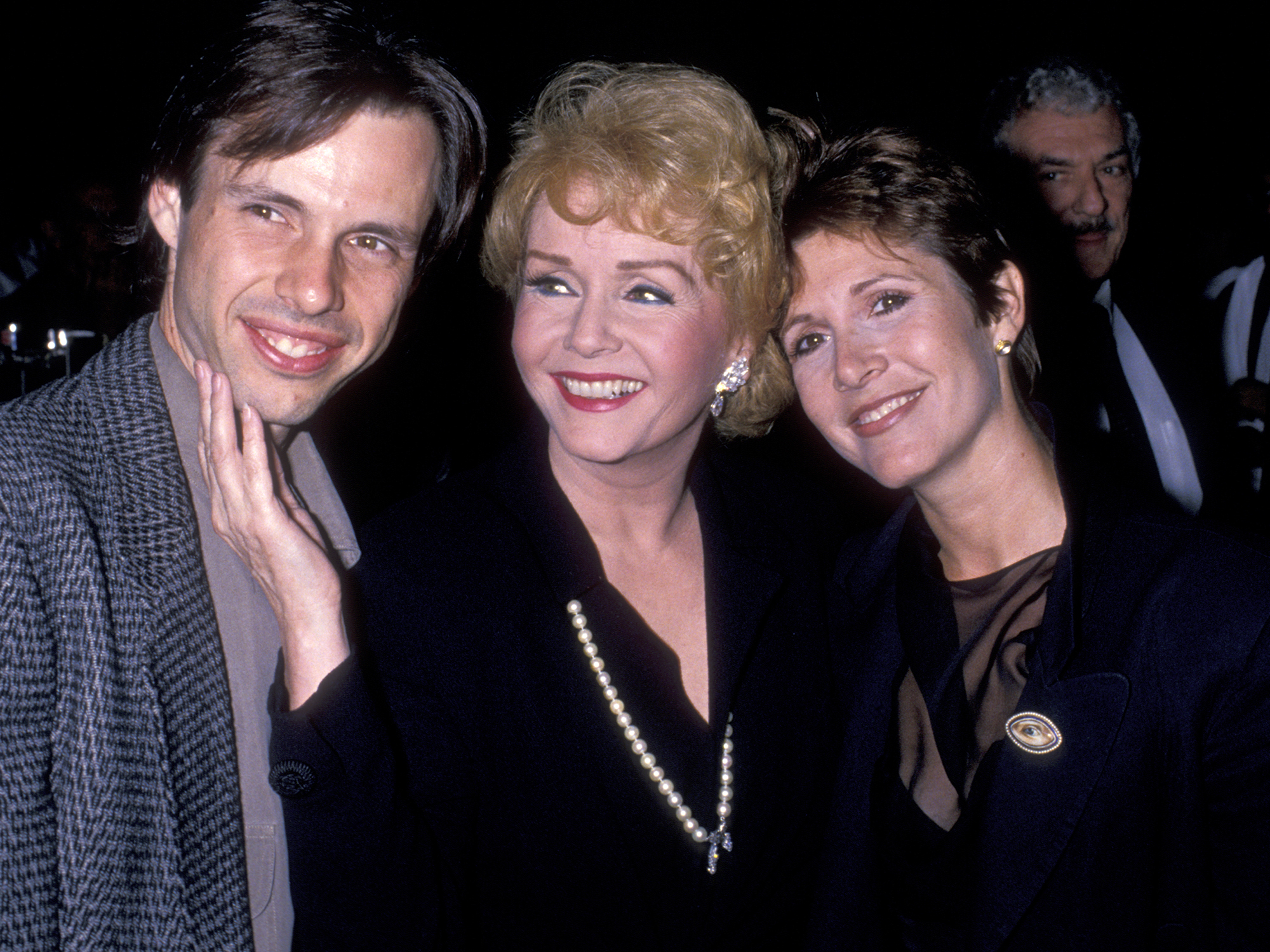 "HOLLYWOOD, CA - SEPTEMBER 19: (L-R) Todd Fisher, Debbie Reynolds and Carrie Fisher attend ""The Unsinkable Molly Brown"" Opening on September 19, 1989 at the Pantages Theater in Hollywood, California. (Photo by Ron Galella/WireImage)"