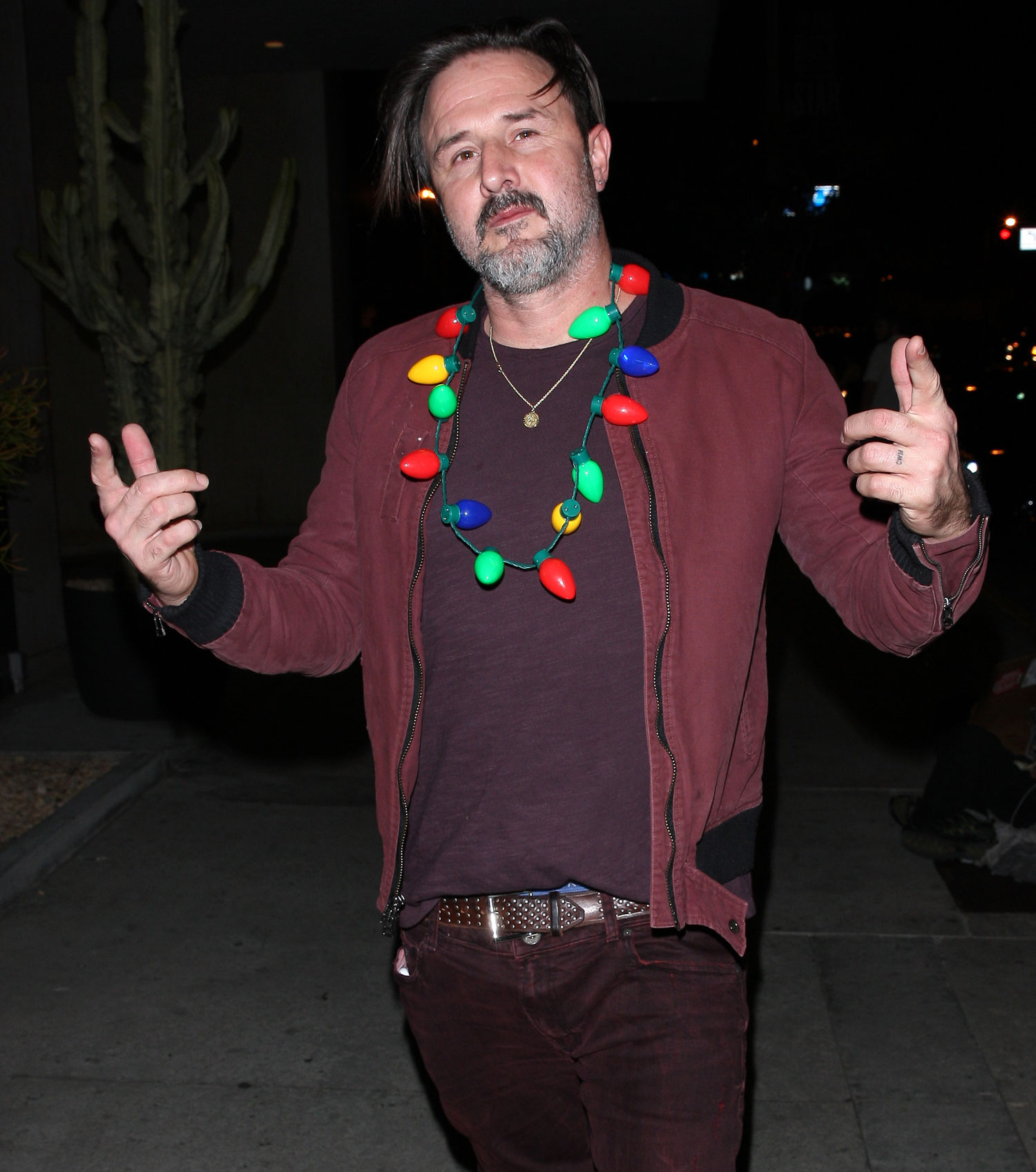 EXCLUSIVE: David Arquette gets in the holiday spirit by wearing a Christmas light necklace after leaving Bootsy Bellows night club
