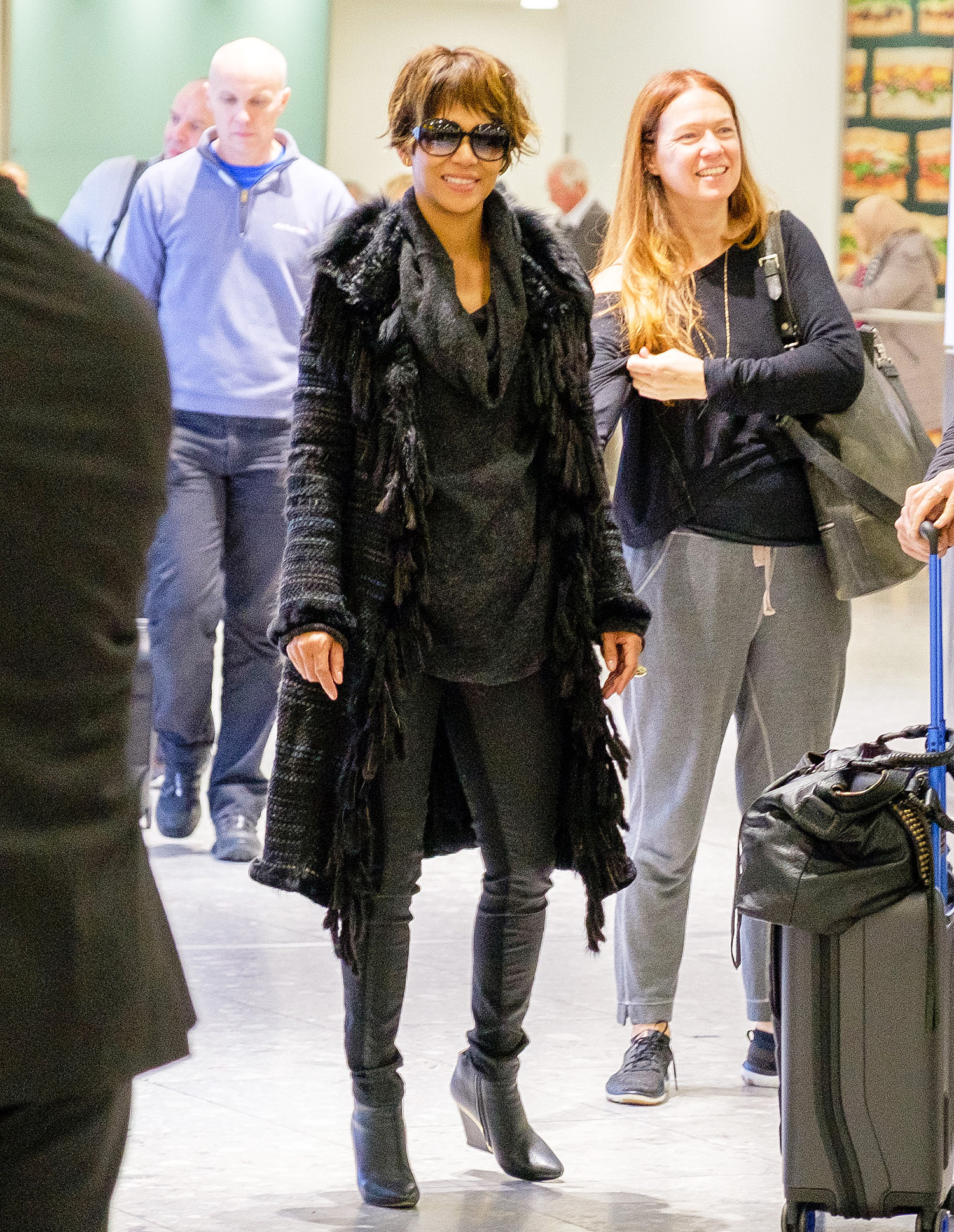 EXCLUSIVE: Halle Berry arrives at Heathrow Airport