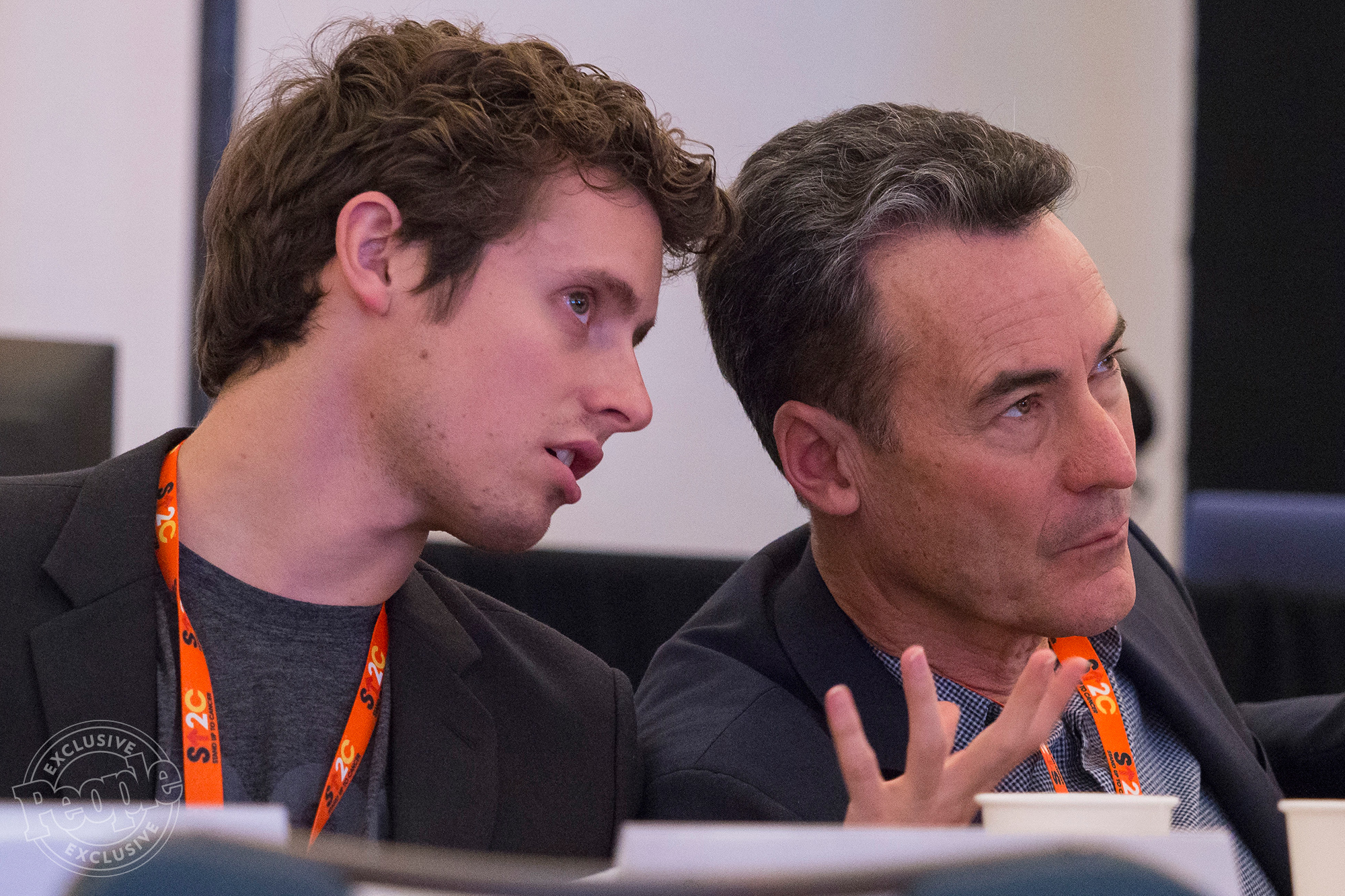 `Santa Monica, CA - SU2C Scientific Summit 2017 - Survivor's Adam Klein, left, chats with his father, Adam Klein, during a presentation by a Stand Up 2 Cancer Lung Cancer team here today, Monday January 23, 2017, during the Stand Up 2 Cancer Scientific Summit. Klein's mother died from stage four lung cancer just two days after the show ended. The SU2C Dream Teams provided detailed reports on their progress in various areas of cancer research. Photo by © AACR/Todd Buchanan 2017 Technical Questions: todd@medmeetingimages.com