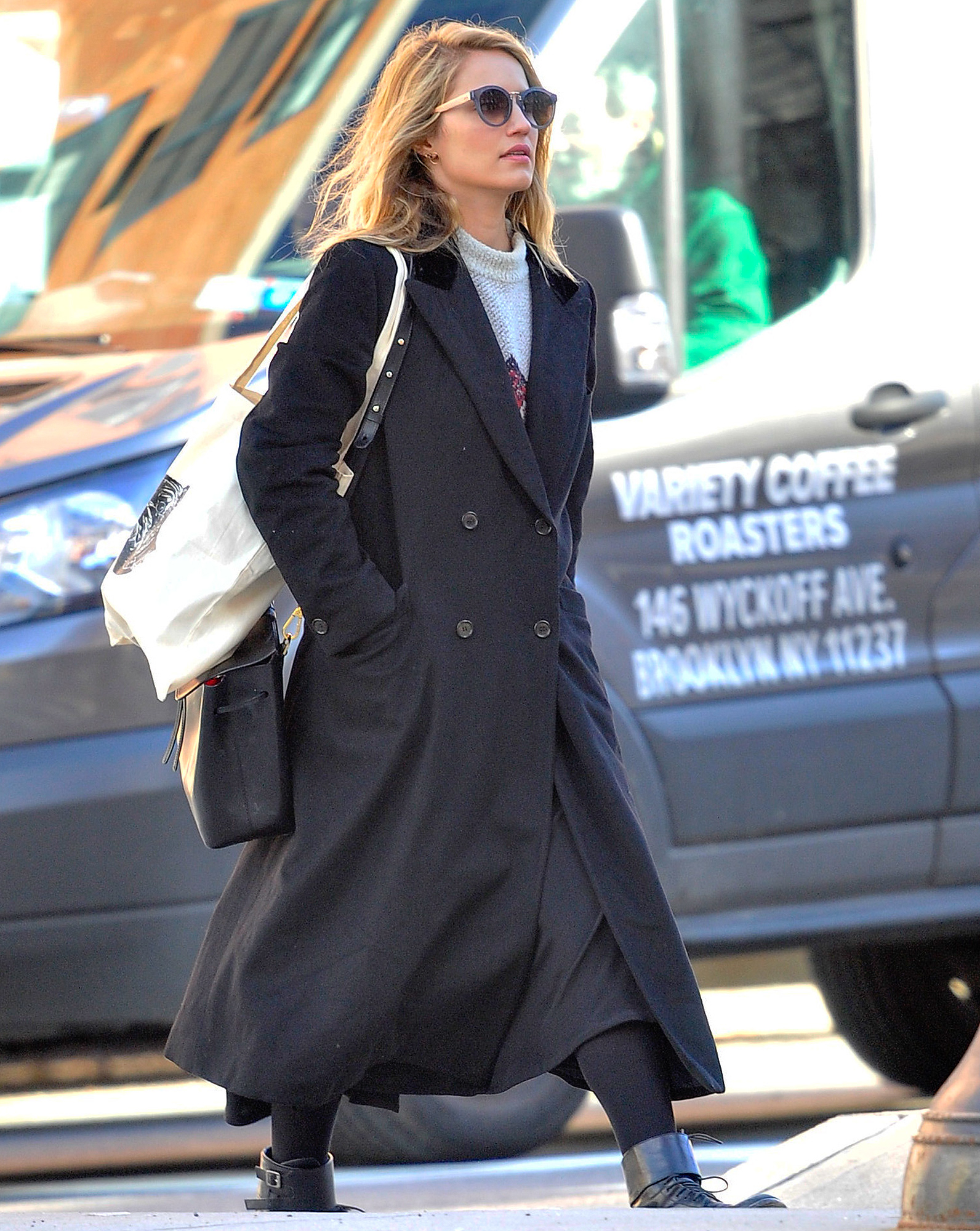 EXCLUSIVE: Dianna Agron wears a large black trench coat as she is seen out in SOHO in New York City.