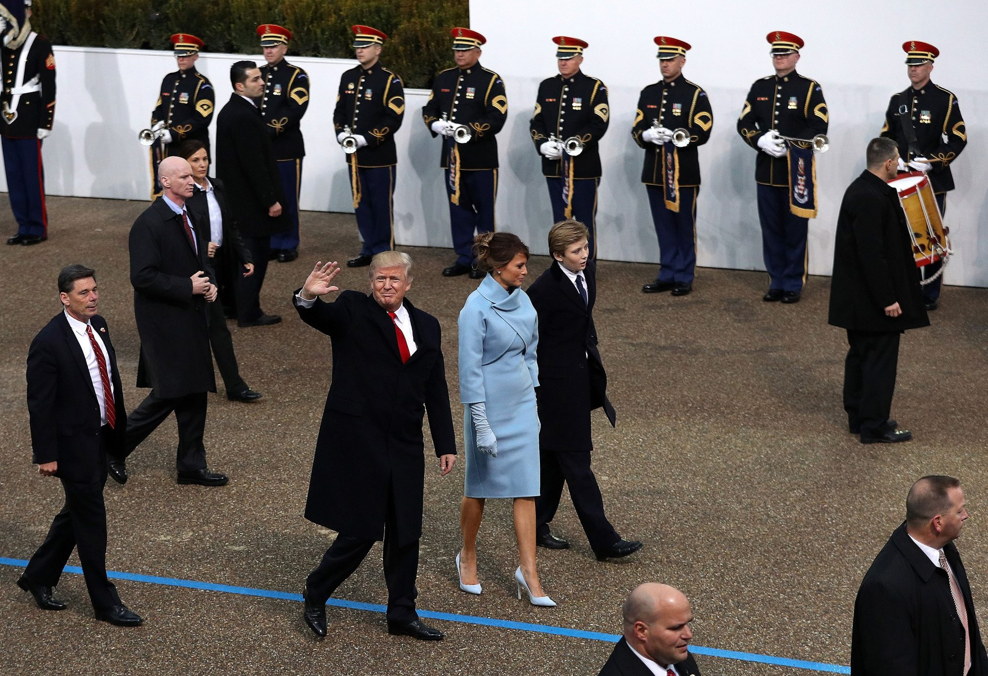 WASHINGTON, DC - JANUARY 20: (L-R) U.S. President Donald Trump waves to supporters as he walks the parade route with first lady Melania Trump and son Barron Trump past the main reviewing stand in front of the White House during the Inaugural Parade on January 20, 2017 in Washington, DC. Donald J. Trump was sworn in today as the 45th president of the United States. (Photo by Patrick Smith/Getty Images) Getty Images North America 693719551 632227502