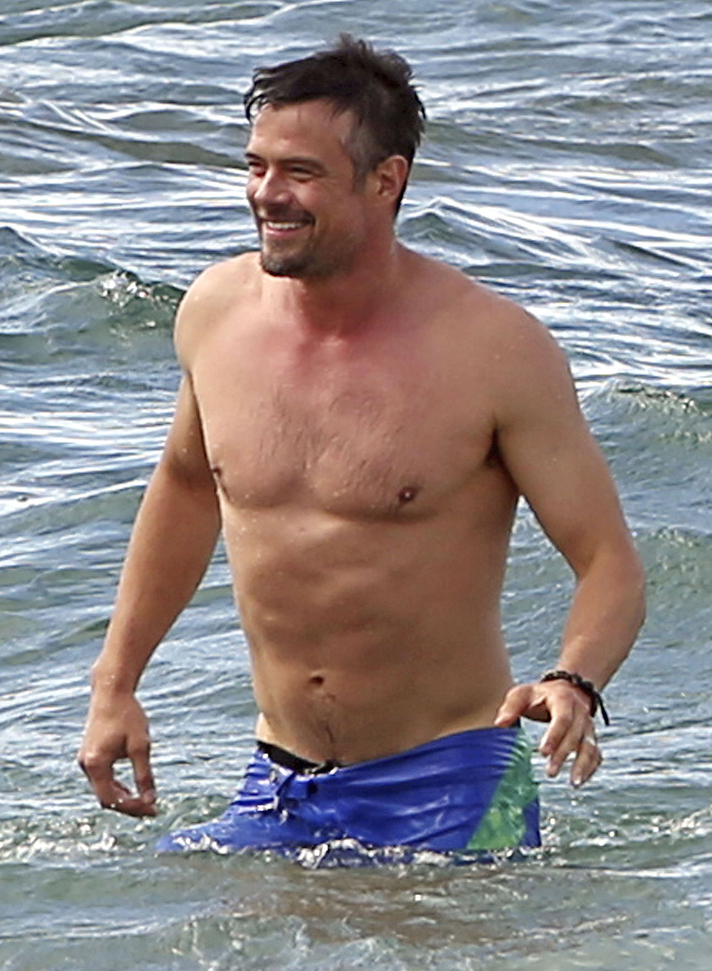 *PREMIUM EXCLUSIVE* Kihei, HI - Fergie and Josh Duhamel enjoy the beach during their Hawaiian holiday vacation. Josh Duhamel is seen stepping out of the water showing off his toned bod before posing with a fan as an excited Fergie looks on in the background. The couple seem to be enjoying their New Year's Eve on the Hawaiian beach. Shot on 01/01/11 **MANDATORY CREDIT MUST READ: FameFlynet/AKM-GSI** AKM-GSI January 03, 2017 To License These Photos, Please Contact : Maria Buda (917) 242-1505 mbuda@akmgsi.com sales@akmgsi.com or Mark Satter (317) 691-9592 msatter@akmgsi.com sales@akmgsi.com www.akmgsi.com