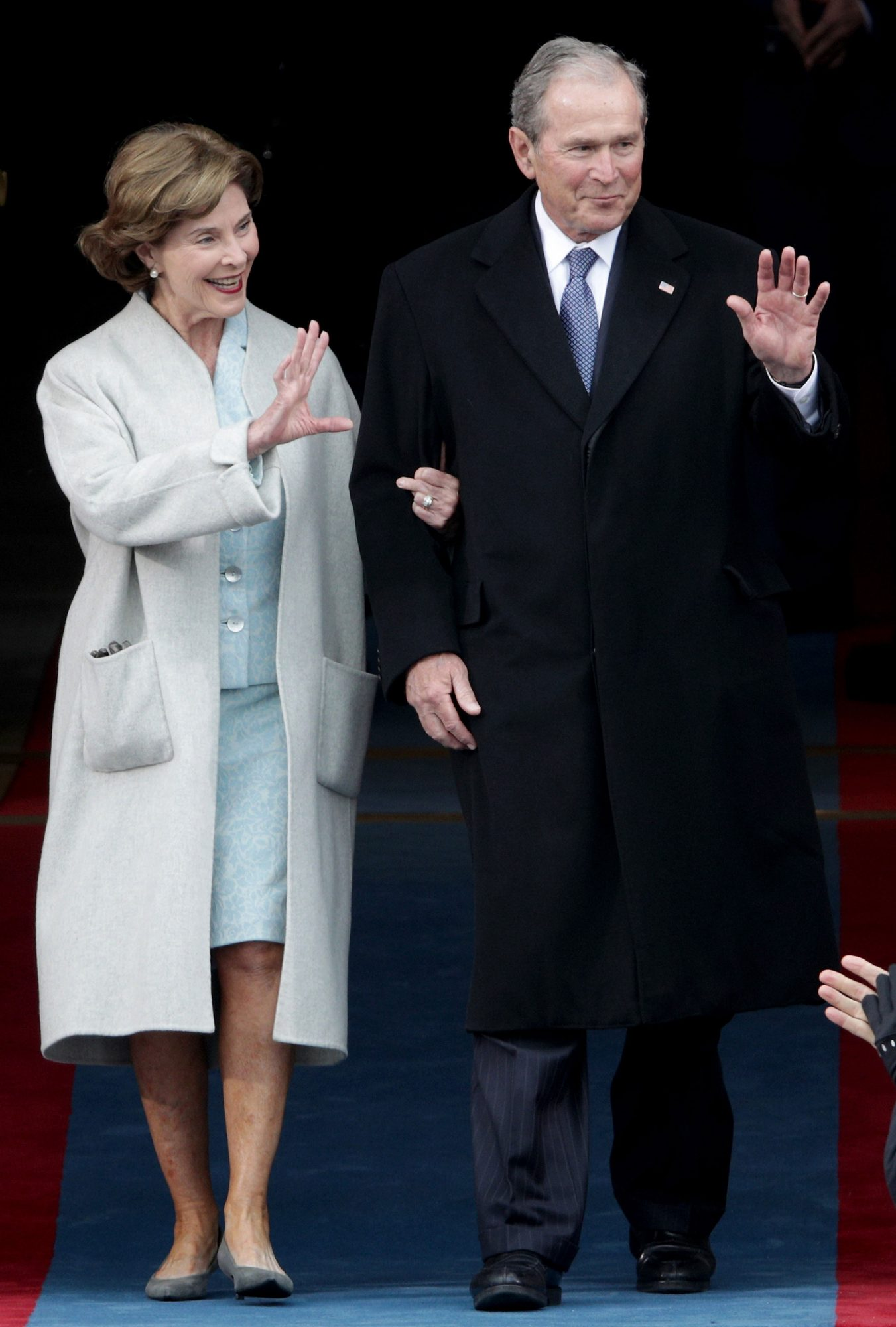 WASHINGTON, DC - JANUARY 20: Former President George W. Bush and Laura Bush wave as they arrive on the West Front of the U.S. Capitol on January 20, 2017 in Washington, DC. In today's inauguration ceremony Donald J. Trump becomes the 45th president of the United States. (Photo by Alex Wong/Getty Images)