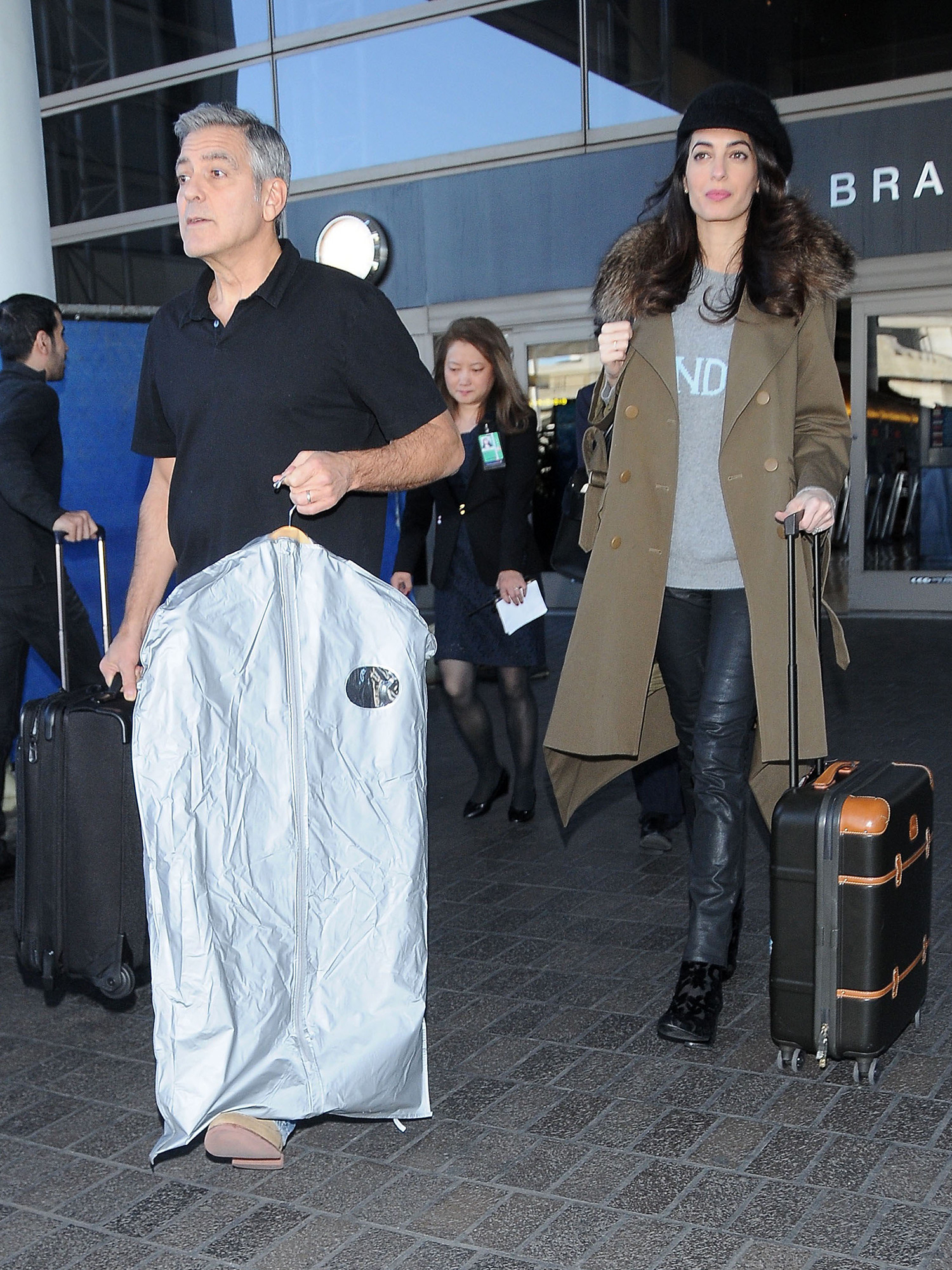 52296140 Actor George Clooney and his pregnant wife Amal Alamuddin are seen arriving on a flight at LAX airport in Los Angeles, California on January 27, 2017. The couple are expecting twins and have been busy preparing a million dollar nursery at their home. FameFlynet, Inc - Beverly Hills, CA, USA - +1 (310) 505-9876