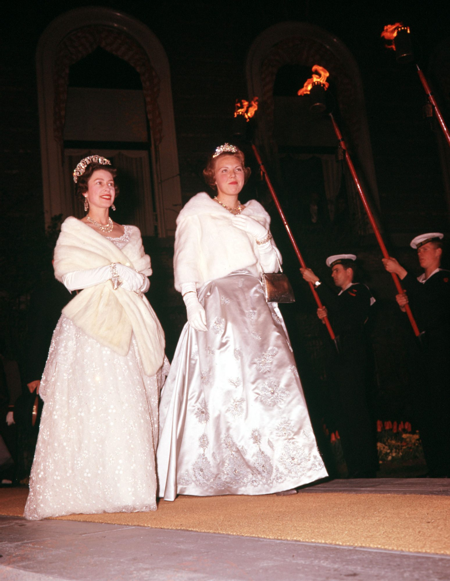1962. 25th Wedding Anniversary of Queen Juliana and Prince Bernhard of Holland. Queen Elizabeth II of Great Britain (left) and Dutch Princess Beatrix come on board the Oranje.