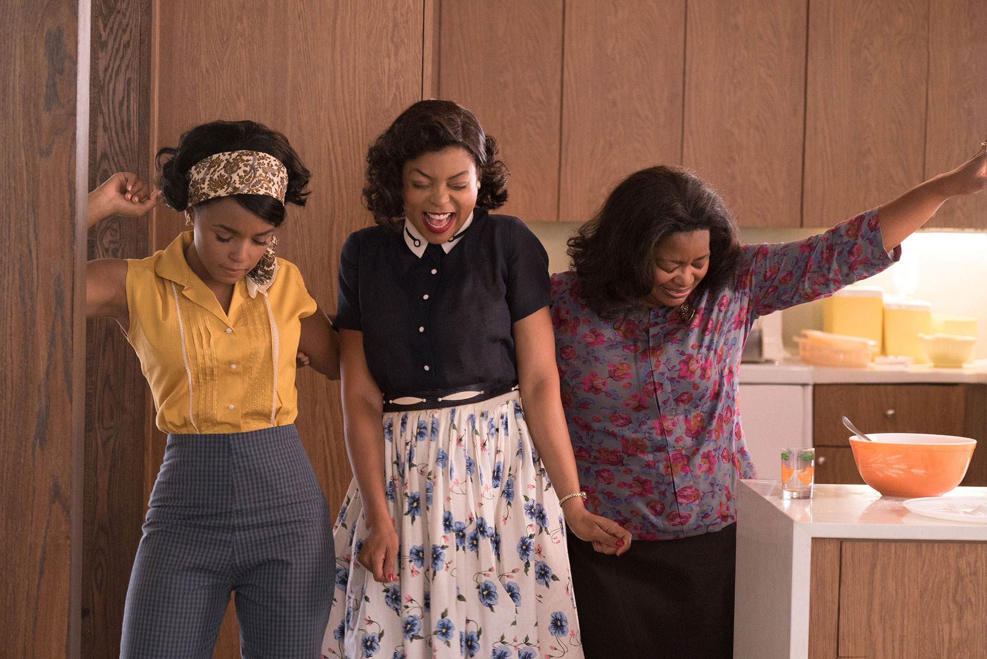DF-03283_R3 - Mary Jackson (Janelle Monae, left), Katherine Johnson (Taraji P. Henson) and Dorothy Vaughan (Octavia Spencer) celebrate their stunning achievements in one of the greatest operations in history. Photo Credit: Hopper Stone. Hidden Figures Day 17 TM & © 2016 Twentieth Century Fox Film Corporation. All Rights Reserved. Not for sale or duplication. Hidden Figures HIDDEN FIGURES