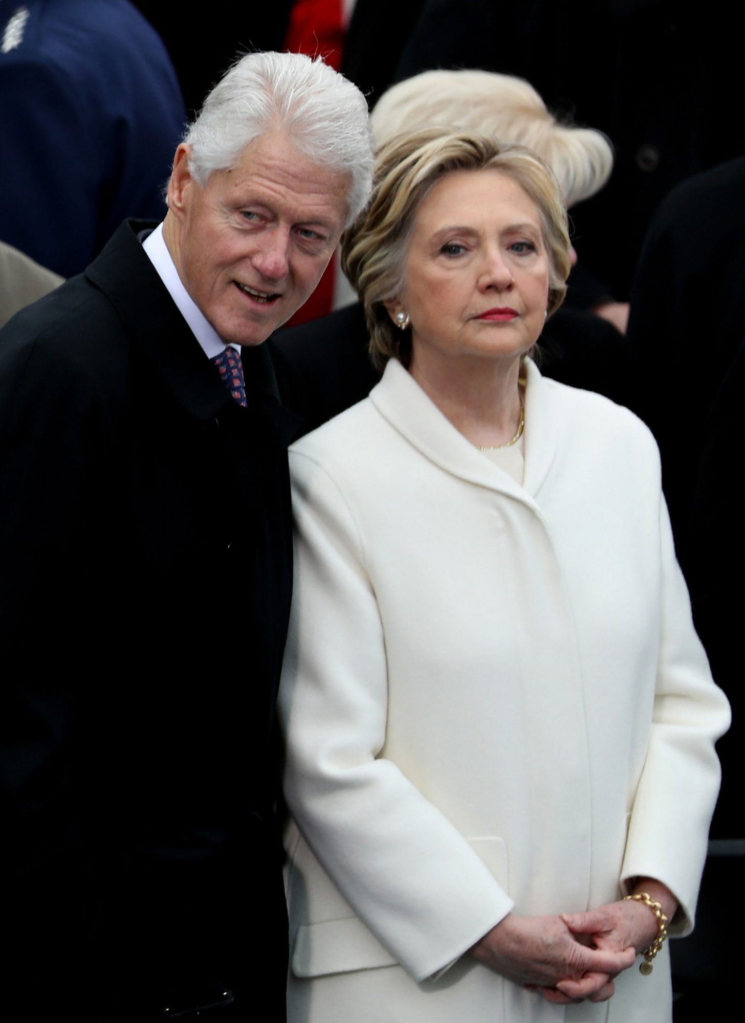 WASHINGTON, DC - JANUARY 20: Former President Bill Clinton and former Democratic presidential nominee Hillary Clinton stand on the West Front of the U.S. Capitol on January 20, 2017 in Washington, DC. In today's inauguration ceremony Donald J. Trump becomes the 45th president of the United States. (Photo by Joe Raedle/Getty Images)