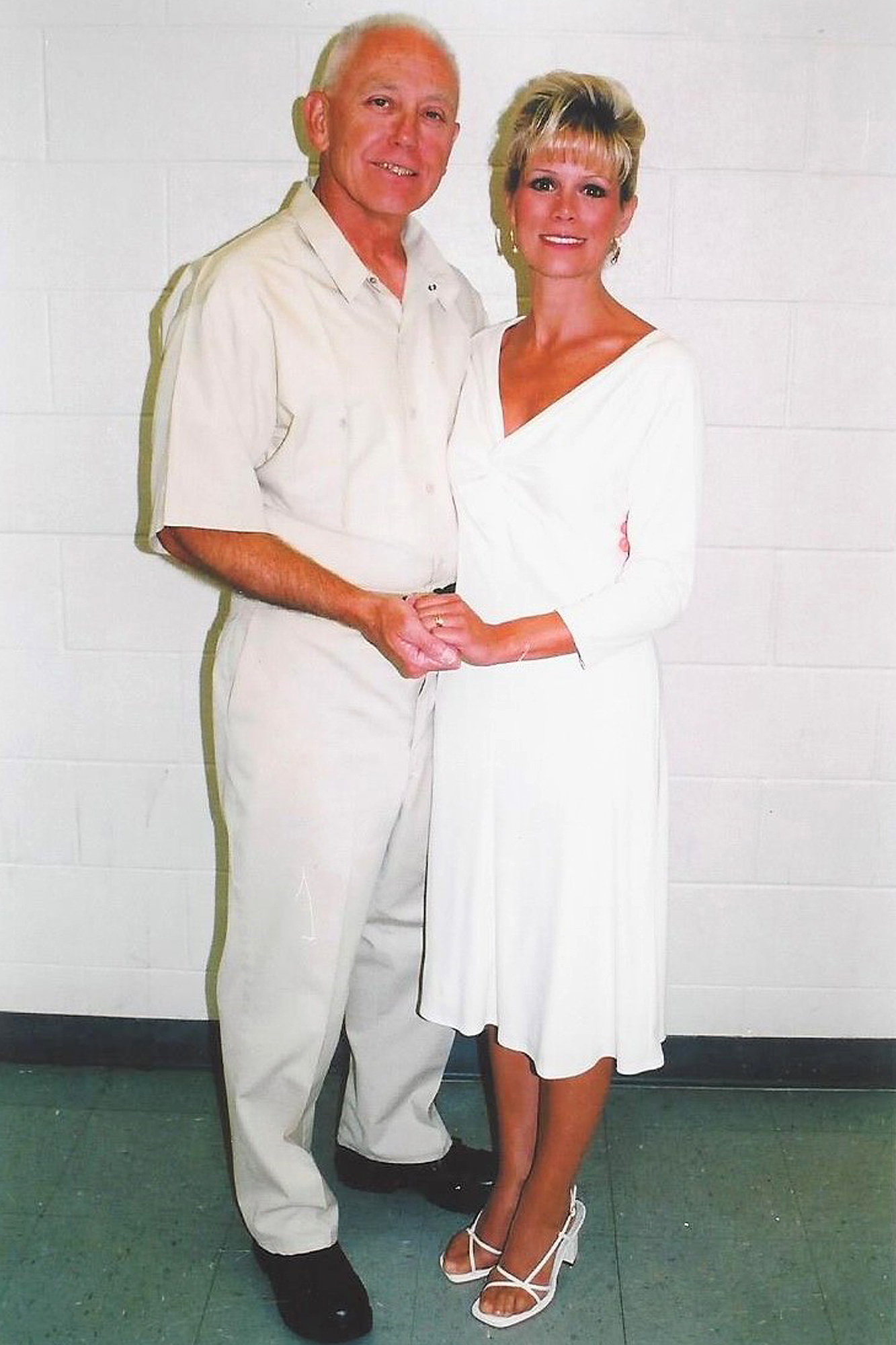Kathryn and Jeff MacDonald's wedding, August 30, 2002, Legal Room at FCI Victorville, CA. first photo right after the ceremony. the inmate who took the photo stole rice from the kitchen to through at the couple.