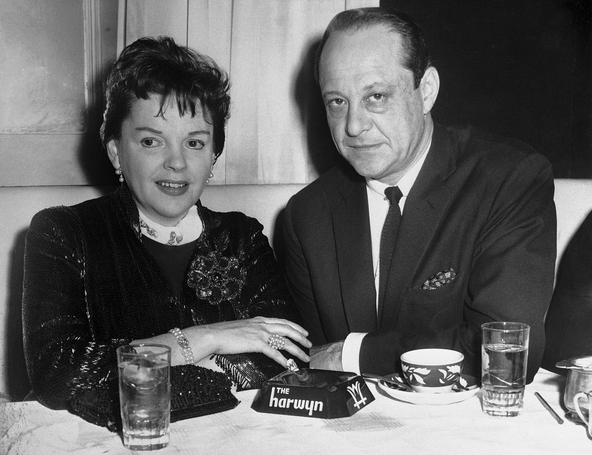 Judy Garland and Husband Sitting at Table