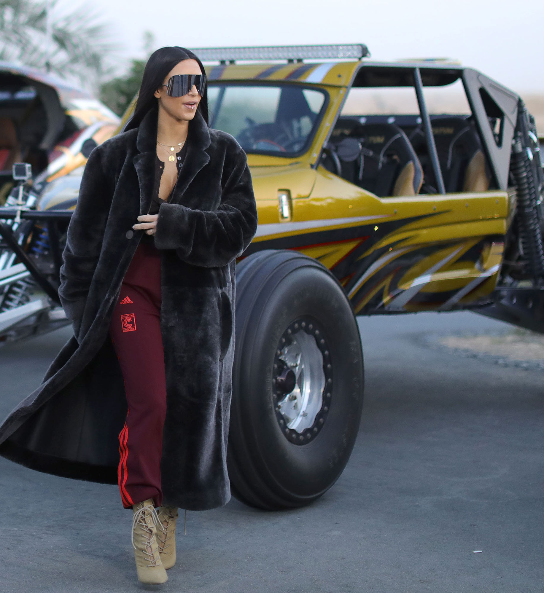 **EXCLUSIVE** Kim Kardashian goes ATV riding in the desert at sundown, is greeted by Royal family and hold exotic bird while touring Dubai for her first official overseas trip of 2017