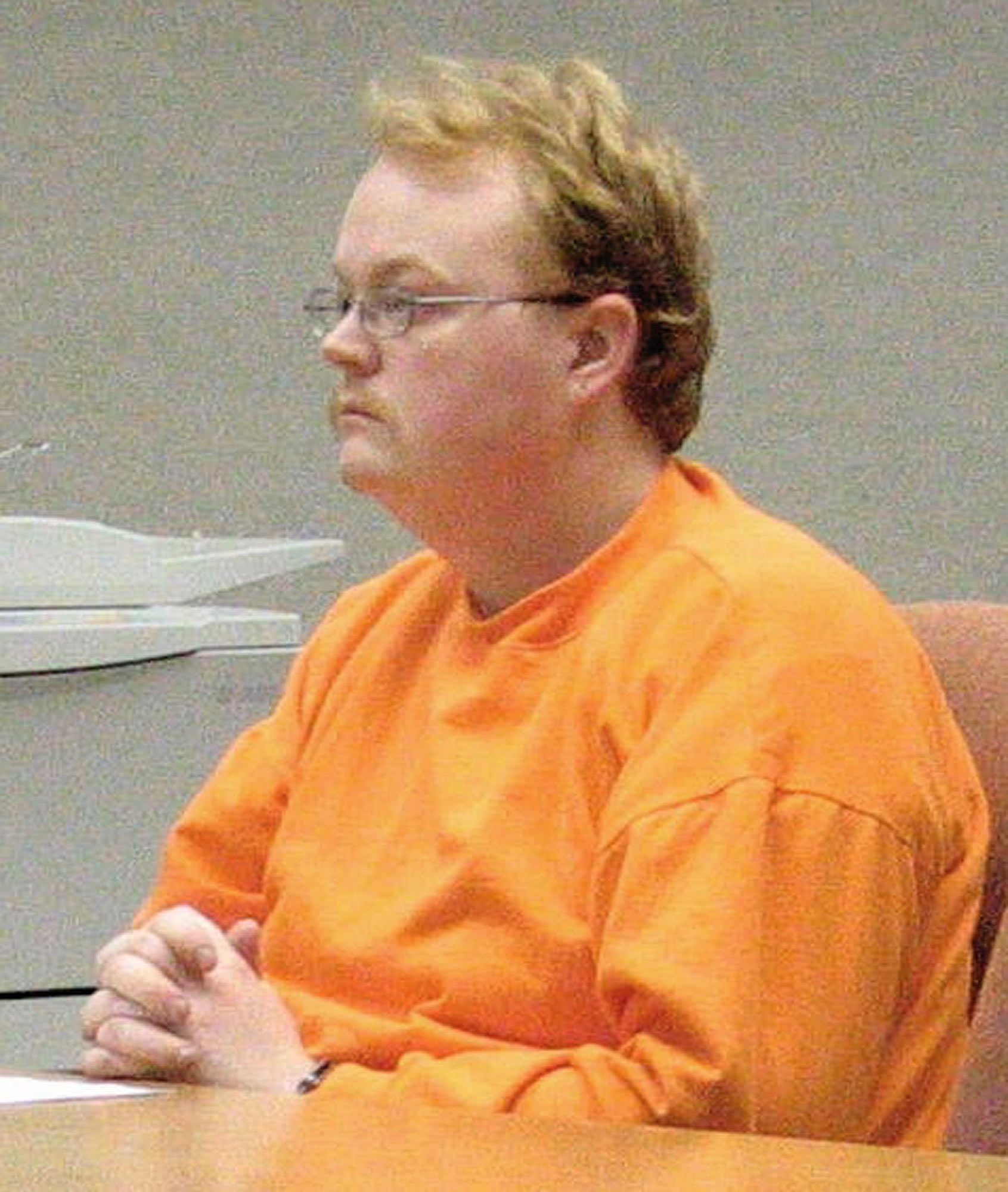 Jason Arrant, 24, listens as Magistrate Kay Clark reads a complaint charging him with first-degree murder in the Nov. 14, 2004, death of Lauri Waterman, 48, on Prince of Wales Island in Southeast Alaska, Saturday, Nov. 20, 2004, in District Court in Craig, Alaska. (AP Photo/Ketchikan Daily News, Tom Miller)