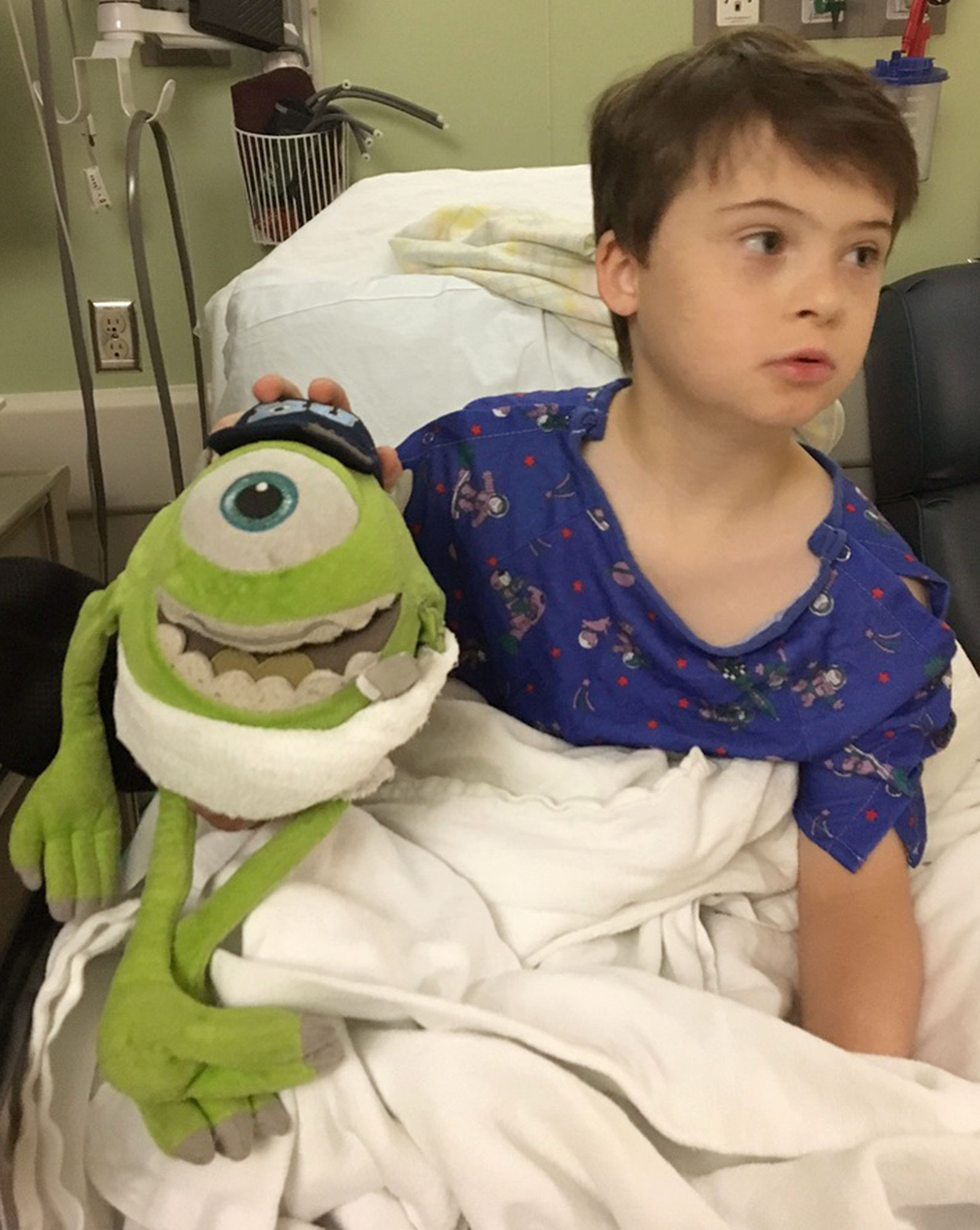 "credit: Children's Hospital of Wisconsin. After Dr. Travis Groth, urologist at Children's Hospital of Wisconsin, completed surgery on 9-year-old Ryan, he noticed that Ryan's stuffed Mike Wozowski doll was a little worse for wear. Ryan has Down syndrome and several other health issues. In his nine years, Ryan has had to undergo eight surgeries – and he's taken his Mike Wozowski doll with him every time. Knowing how important he was to him, Dr. Groth re-assembled his surgical team, prepped the monster, proceeded with a ""time out"" and then sutured the arm. Both Ryan and Mike are recovering well at home."