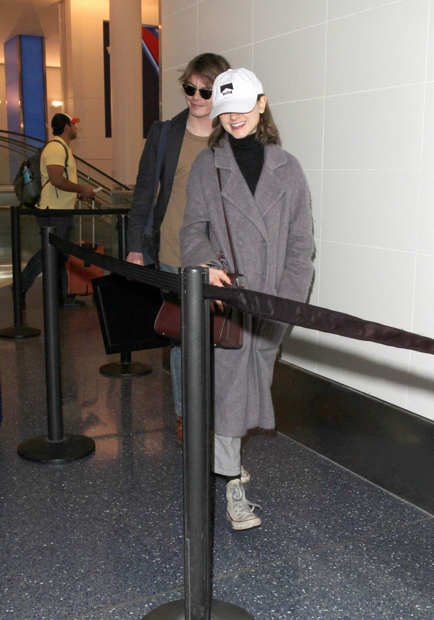 """Natalie Dyer & rumored boyfriend and fellow """"Stranger Things"""" co-star, Charlie Heaton are seen flying out of Los Angeles together."""
