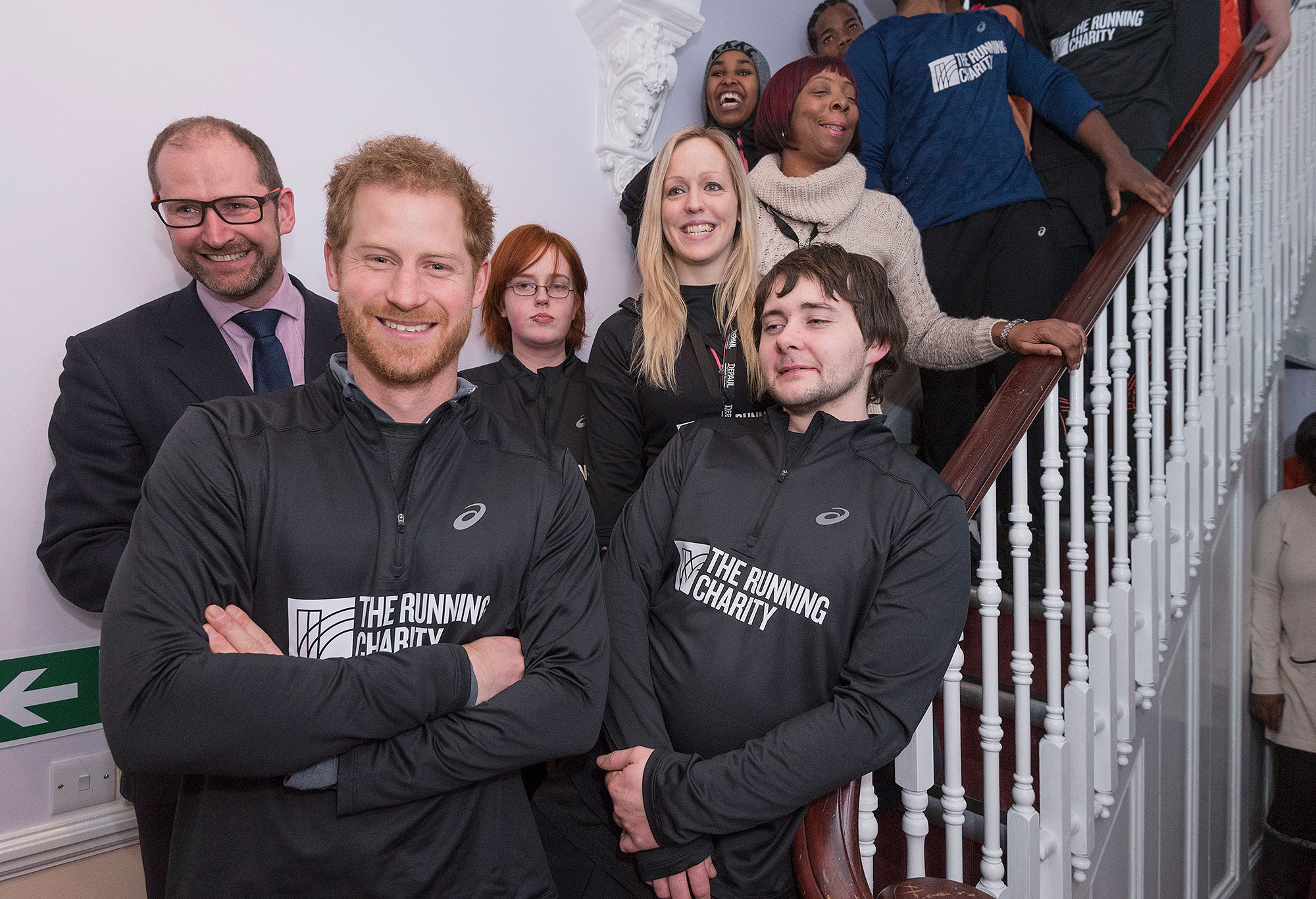 LONDON, UNITED KINGSDOM - JANUARY 26: Prince Harry recreates a picture taken of his mother Princess Diana, with staff and users with staff and users of The Running Charity, which is the UK's first running-orientated programme for homeless and vulnerable young people, on January 26, 2017 in Willesden, north west London, England. (Photo by Geoff Pugh-WPA Pool/Getty Images)