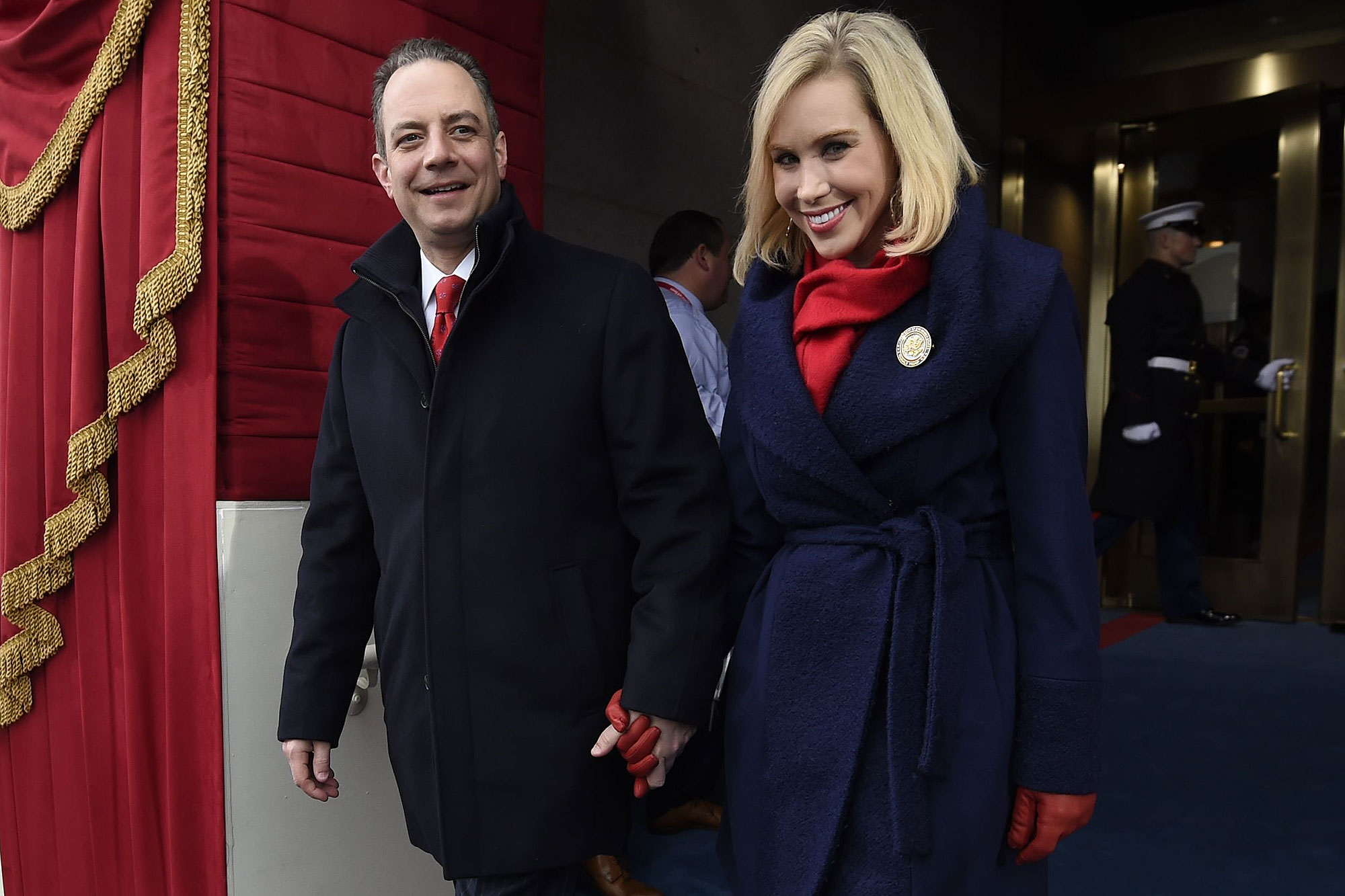 Reince Priebus, White House Chief of Staff to President-elect Donald Trump, and his wife Sally arrive for the Presidential Inauguration at the US Capitol in Washington, DC, January 20, 2017. / AFP / POOL / SAUL LOEB (Photo credit should read SAUL LOEB/AFP/Getty Images)