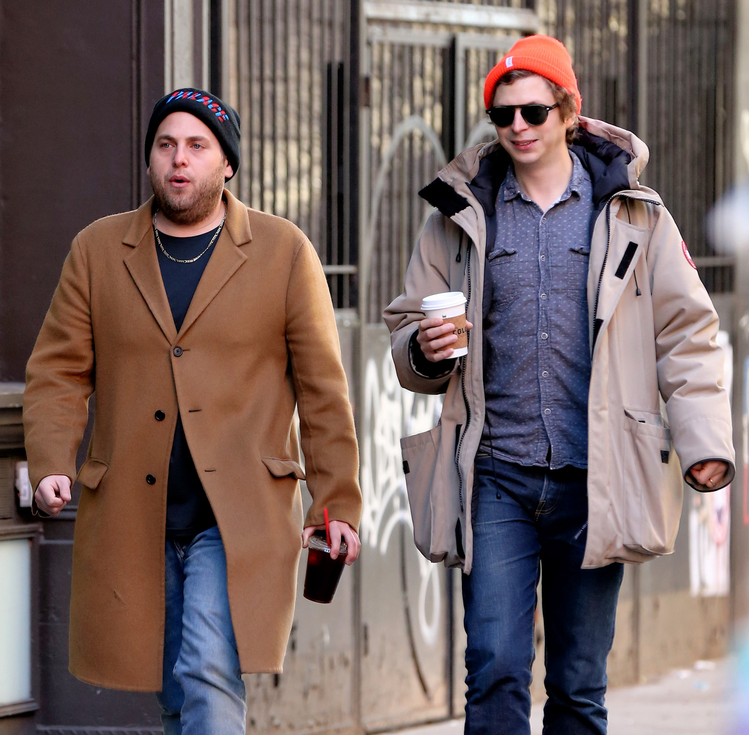 EXCLUSIVE: Actor Jonah Hill, looking slimmed down, grabs an iced coffee with actor Michael Cera on New Year's Day in Soho in New York City