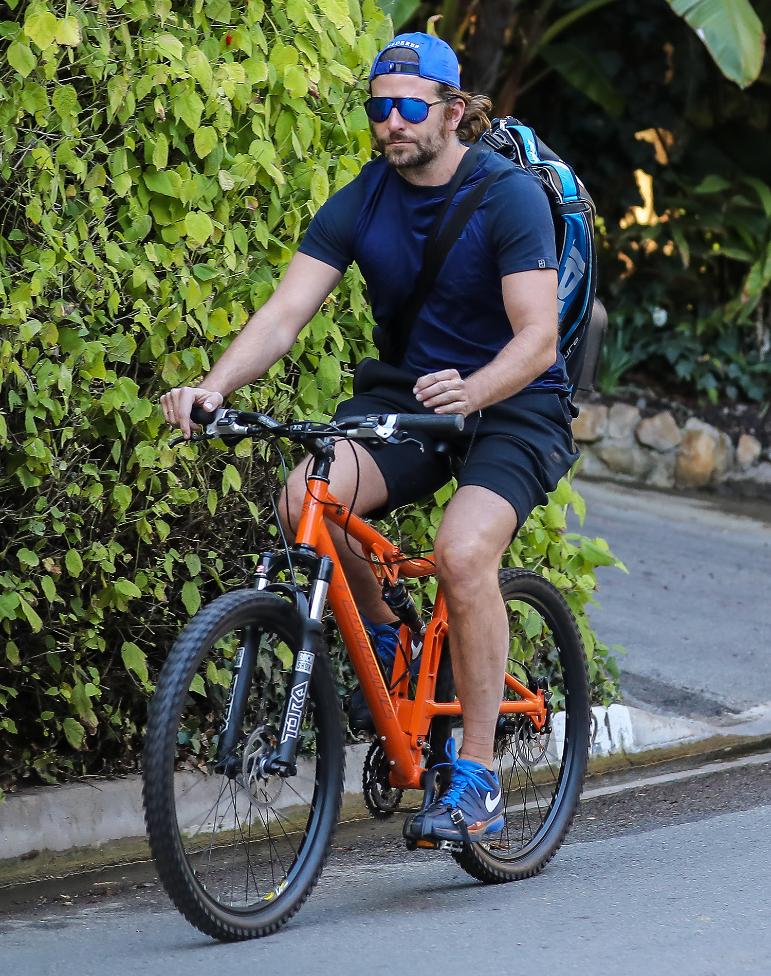 *EXCLUSIVE* Bradley Cooper gets his daily dose of exercise with a bike ride