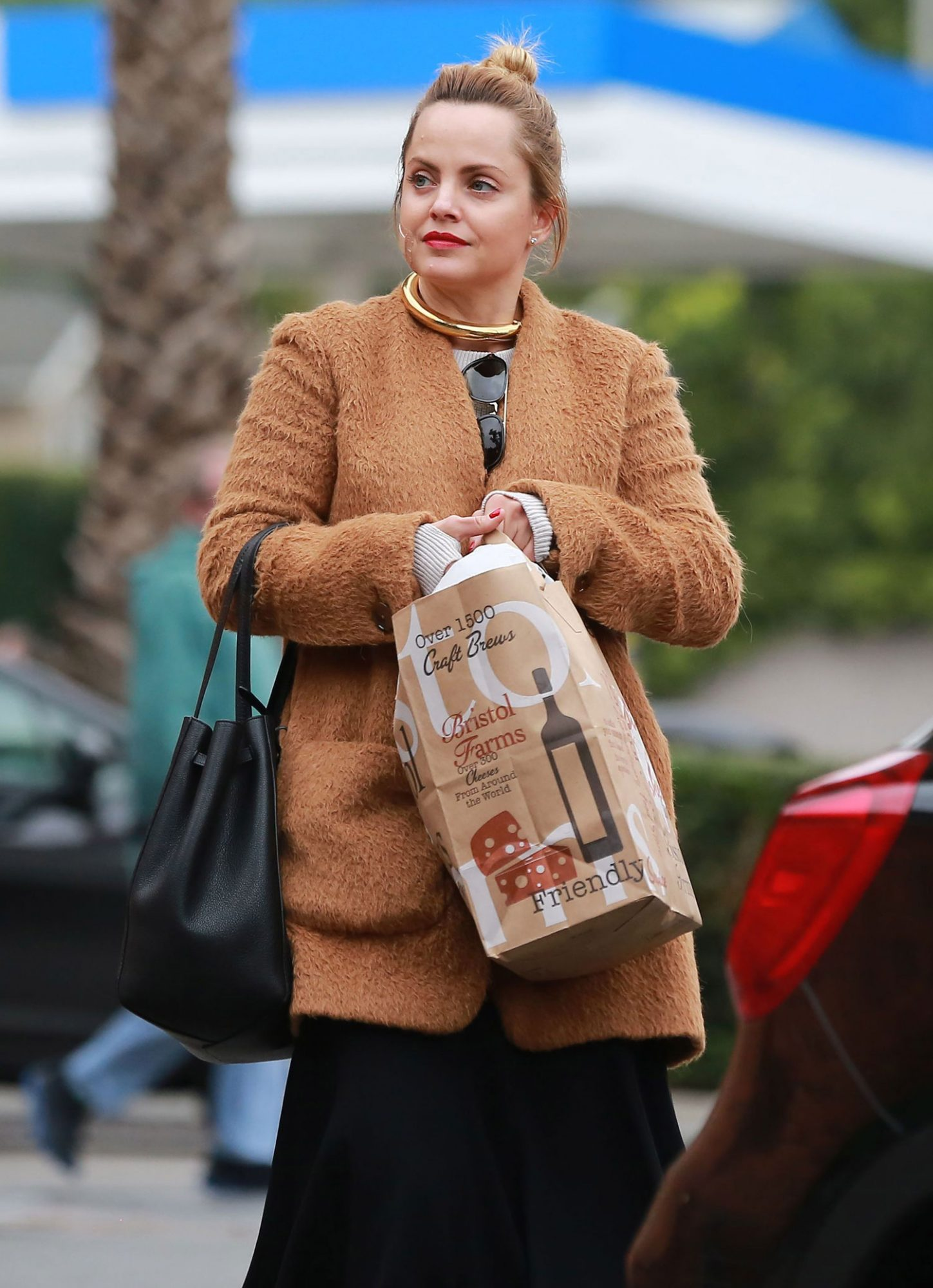 *EXCLUSIVE* Mena Suvari leaves Bristol Farms with a bandage on her Cheek