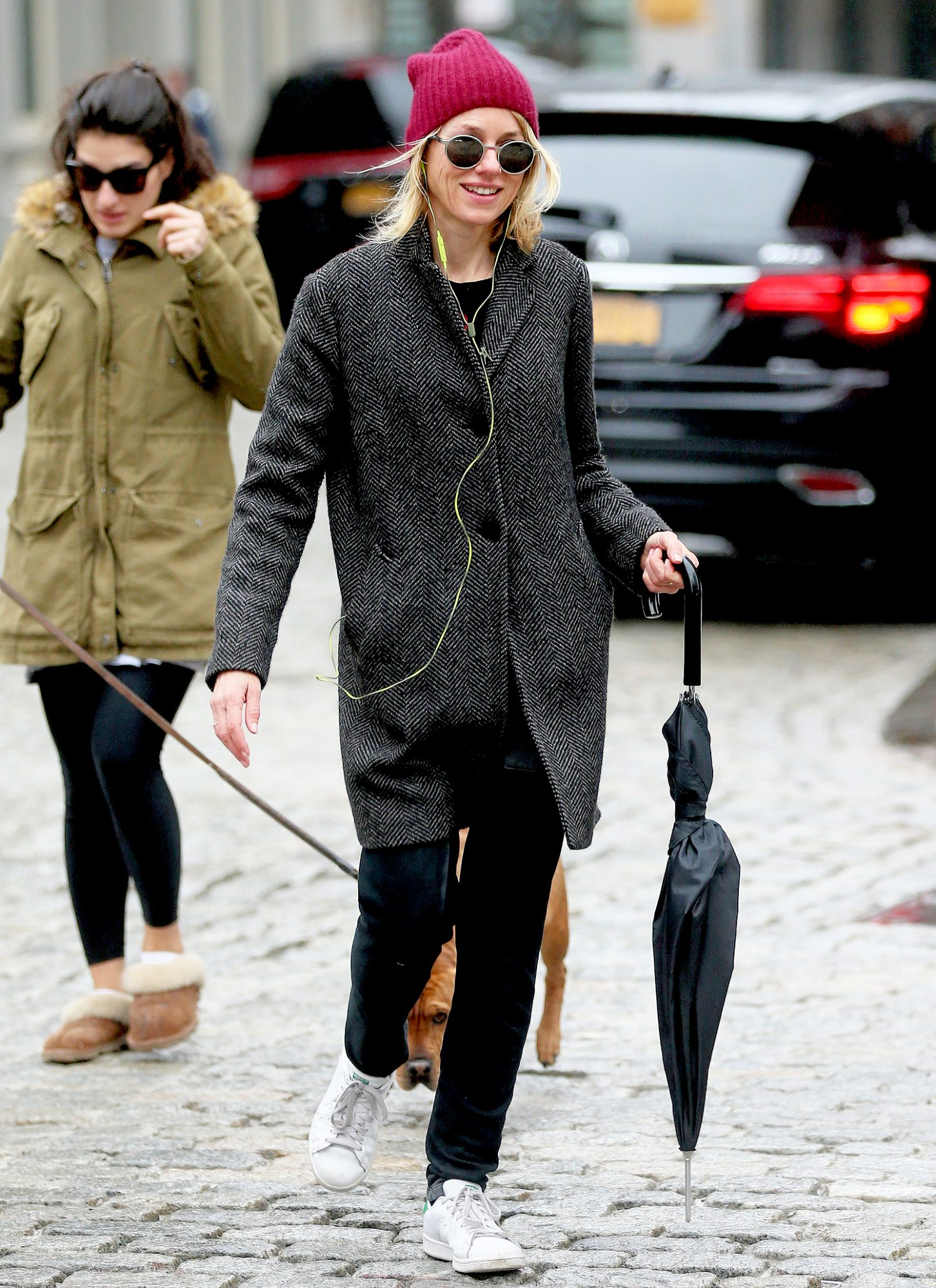 EXCLUSIVE: English actress Naomi Watts walks home listening to music in the rain with her umbrella in New York City