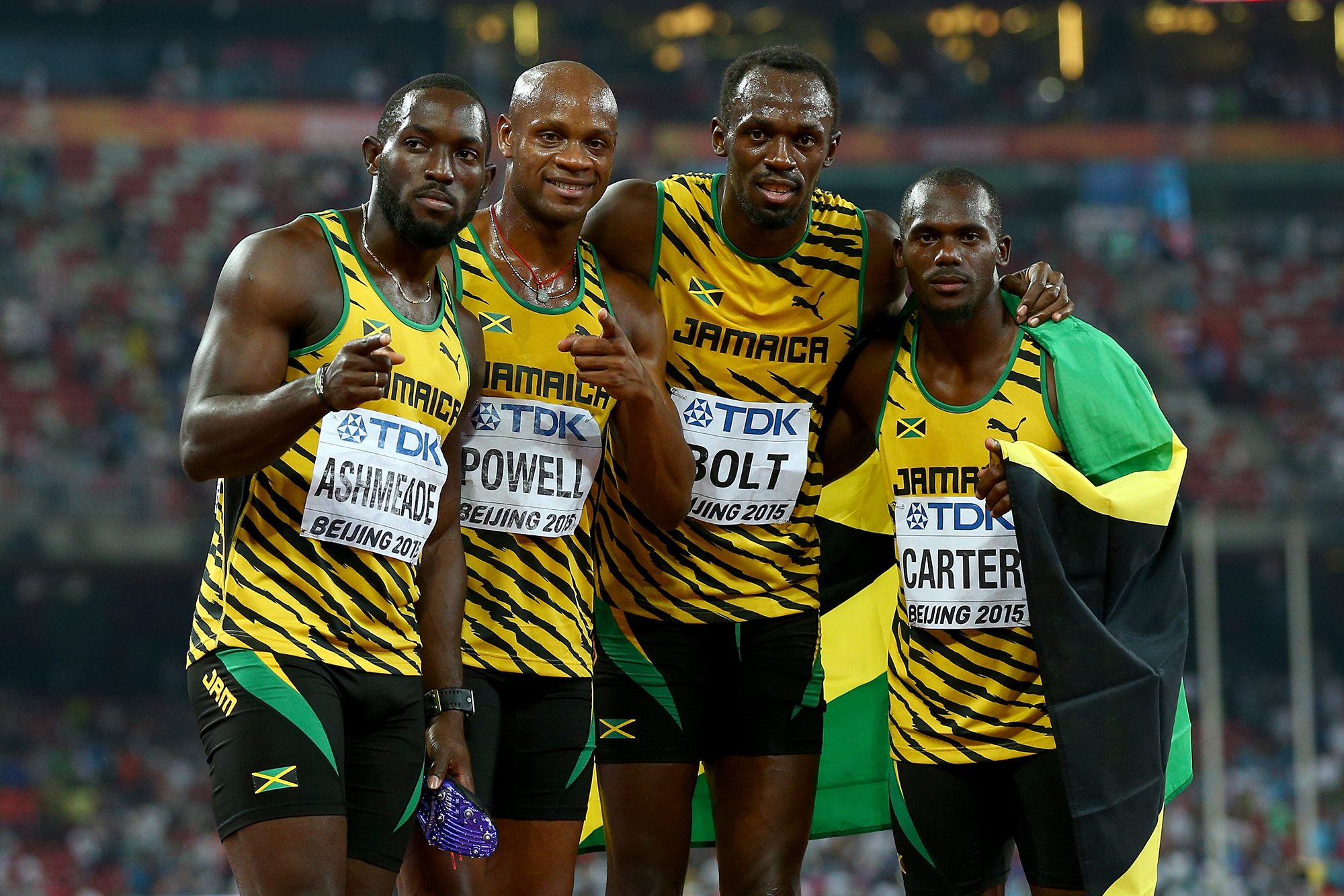 BEIJING, CHINA - AUGUST 29: Nickel Ashmeade of Jamaica, Asafa Powell of Jamaica, Usain Bolt of Jamaica of Jamaica and Nesta Carter of Jamaica celebrate after winning gold in the Men's 4x100 Metres Relay final during day eight of the 15th IAAF World Athletics Championships Beijing 2015 at Beijing National Stadium on August 29, 2015 in Beijing, China. (Photo by Ian Walton/Getty Images)