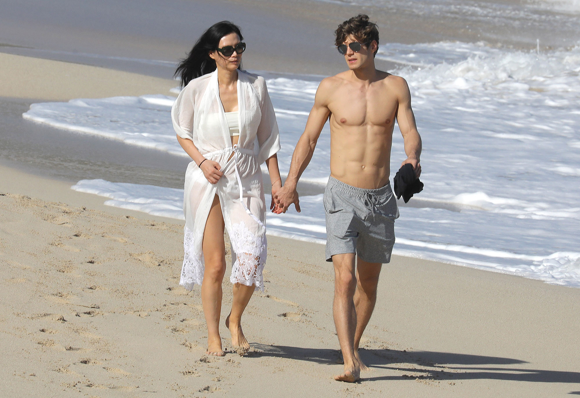 EXCLUSIVE: Rupert Murdoch's famed ex-wife Wendi Deng shows off new toyboy romance during St Barts vacation.