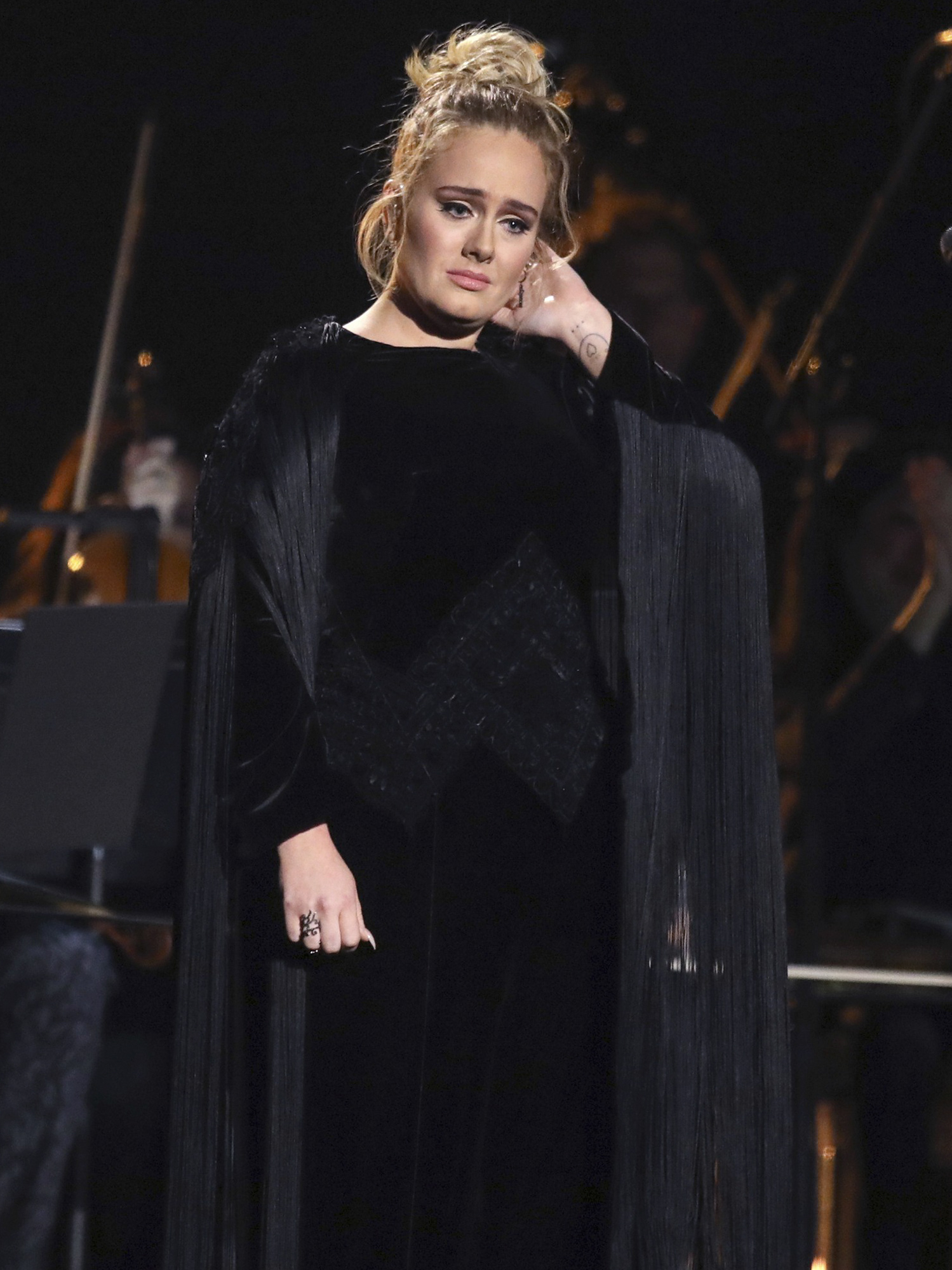 Adele reacts after a performance tribute to George Michael at the 59th annual Grammy Awards on Sunday, Feb. 12, 2017, in Los Angeles. (Photo by Matt Sayles/Invision/AP)