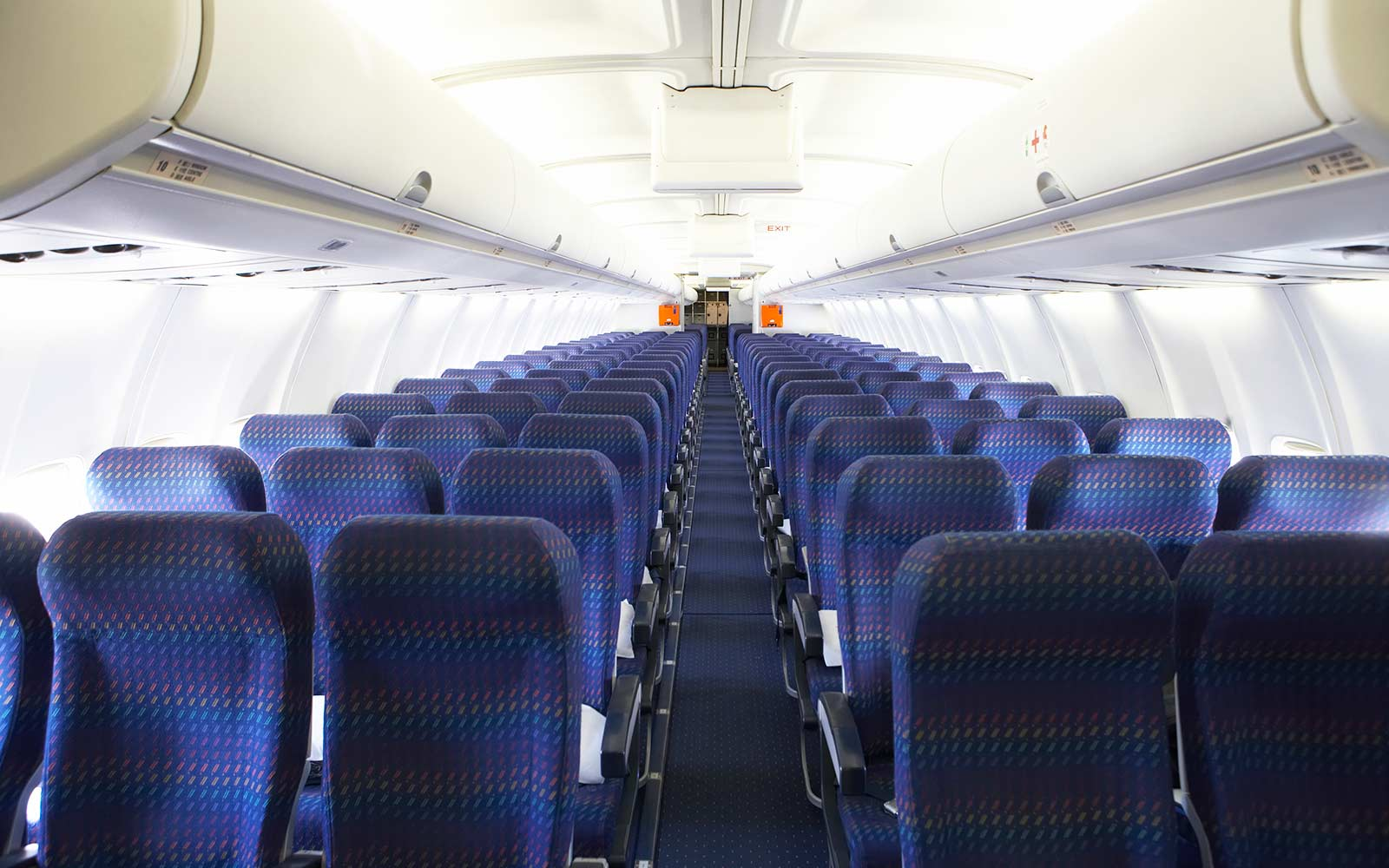Rows of empty seats on airplane
