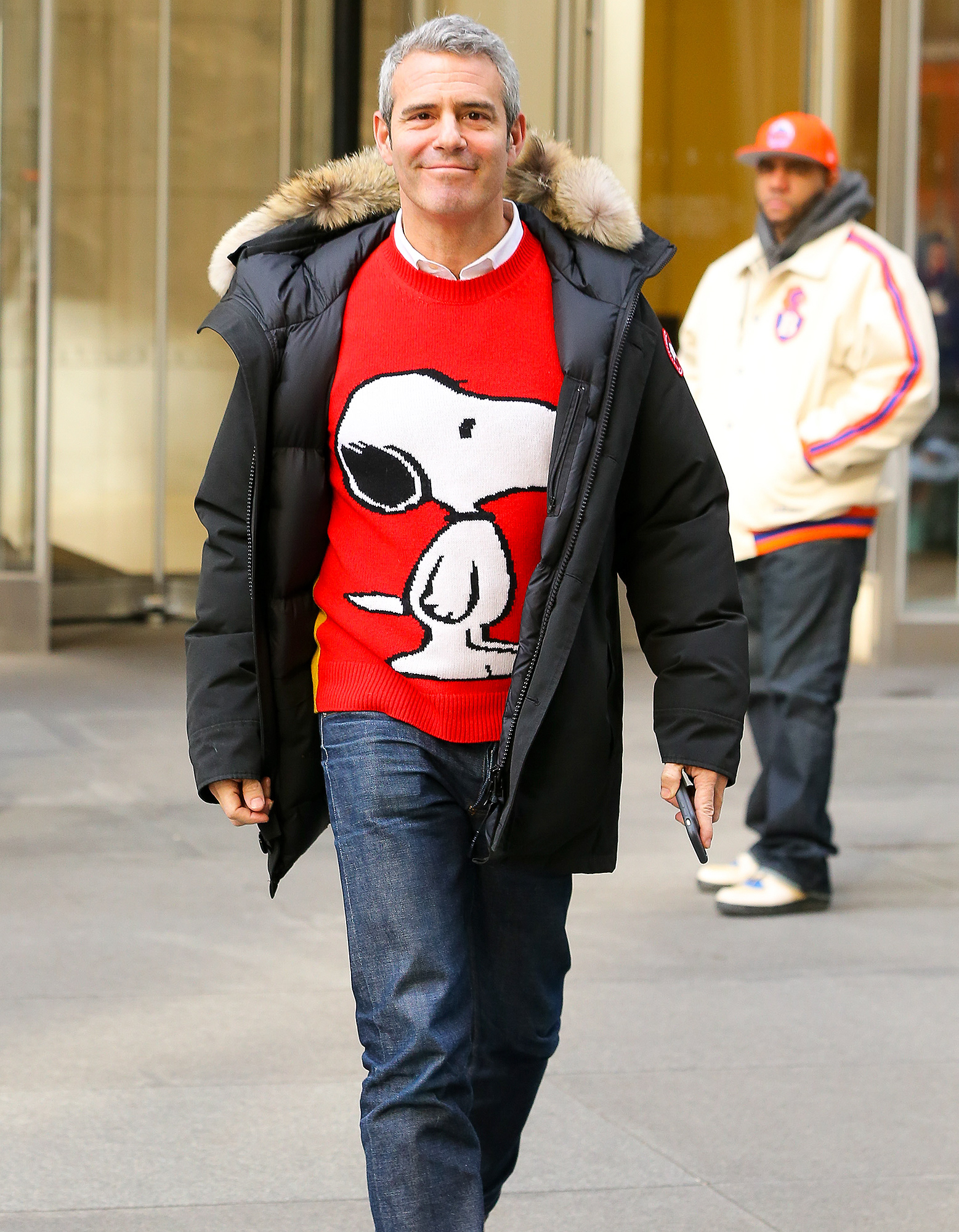 """Andy Cohen is all happy while wearing his red """"Snoopy"""" sweater in New York City"""
